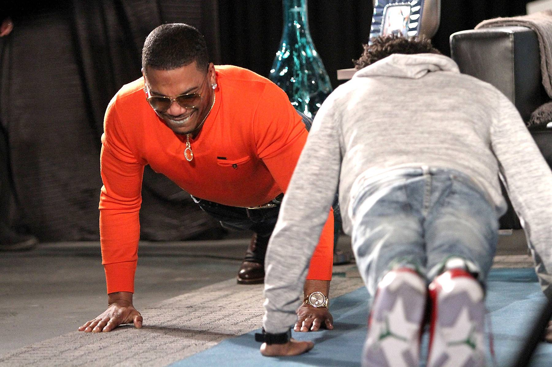 A Little Competition - Nelly shows Tre that he's still the man with the workout plan.   (Photo: Maury Phillips/WireImage)