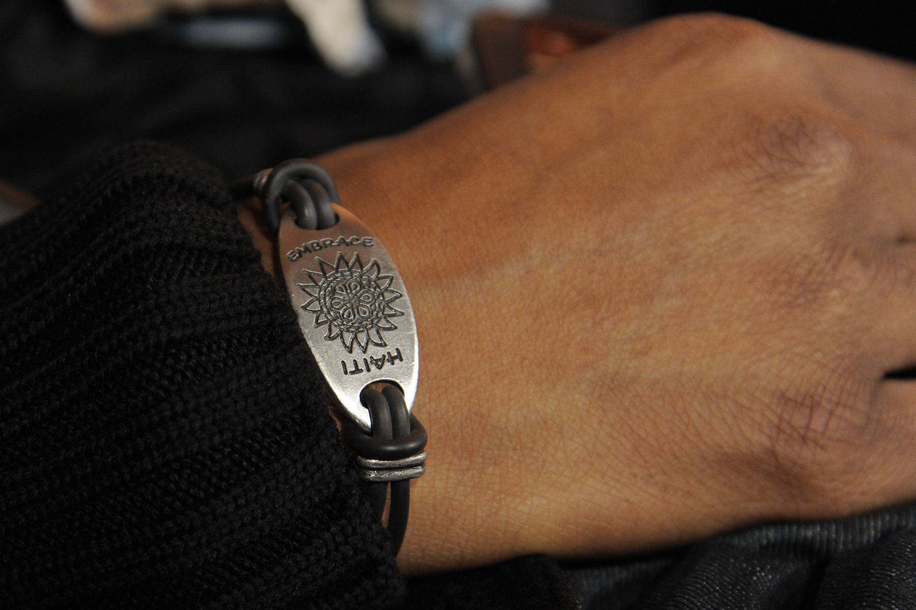 """For a Cause - Pras displays his """"Embrace Haiti"""" bracelet, the sales of which will help send money to the people of Haiti in the green room at 106 & Park, January 12, 2012. (Photo: John Ricard / BET)"""