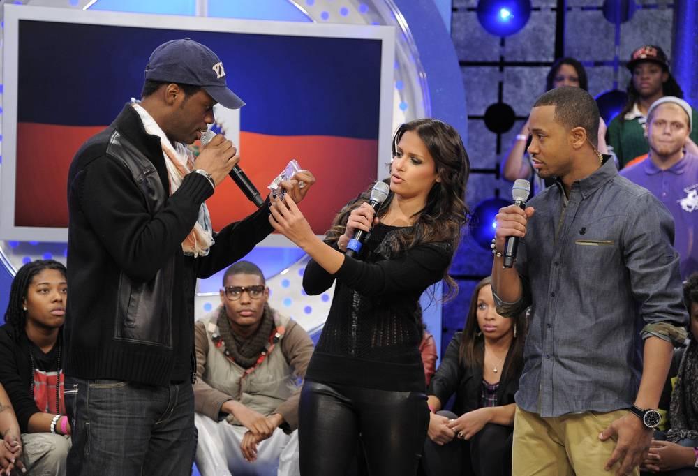 "So Real - Pras presents his ""Embrace Haiti"" bracelets to Rocsi Diaz and Terrence J at 106 & Park, January 12, 2012. (Photo: John Ricard / BET)"