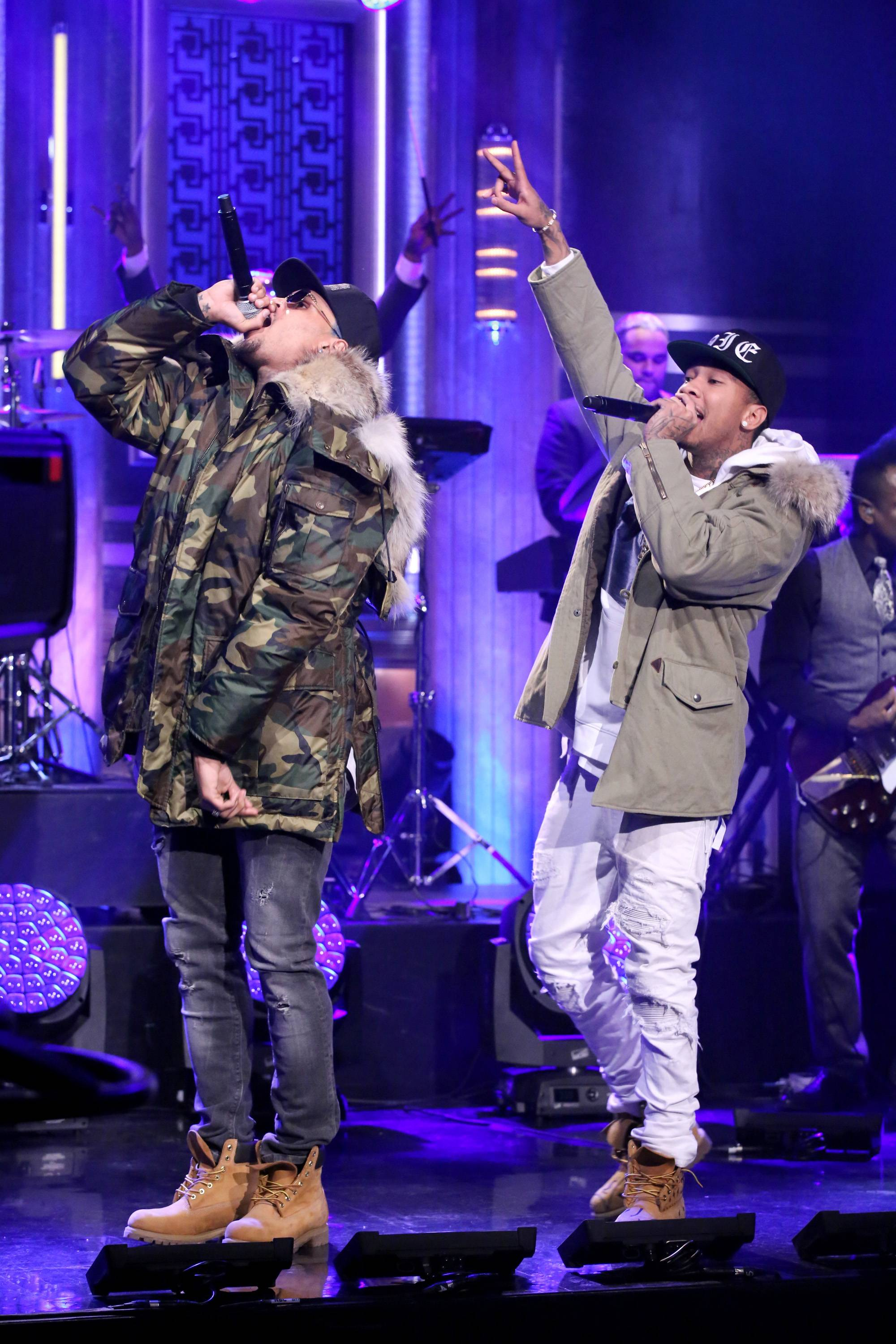 """'Banjo' - It's twerk season as DJ Mustard lays the backdrop for Brown and Tyga to close out their sexcapades. With one thing on his mind, C.B. praises the Lord for his blessings as he raps, """"Shorty got that a** / Baby girl it's nice to meet you /With these lights off, give a f**k about your features.""""(Photo: Douglas Gorenstein/NBC/NBCU Photo Bank via Getty Images)"""