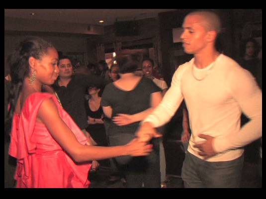 Travelistas:Washington, DC - Travelista Teri shows off her salsa skills at DC?s Indulj.<br><br>Her ruffled dress is the perfect partner for dancing the night away.