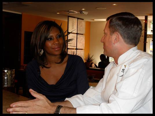 Travelistas:Washington, DC - Here, head chef Joe Raffa of DC?s Oyamel gives Travelista Andrea some cooking pointers.