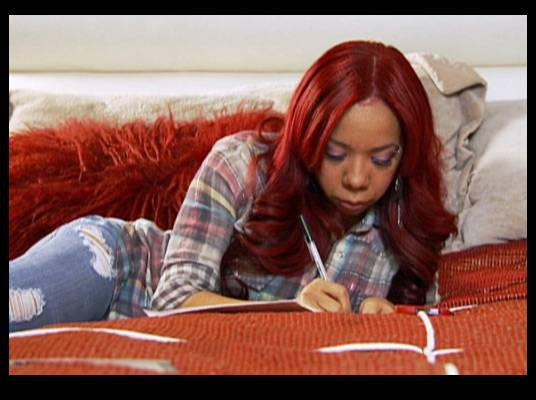Waiting on T.I. - Tiny is preparing for her man's return. She keeps a log of everything he's missed.