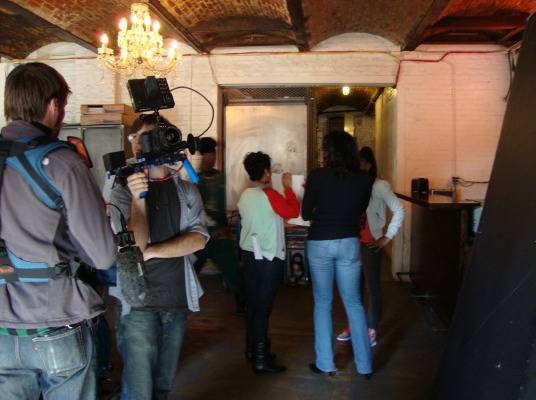 Behind The Scenes - The camera man waits patiently as the hosts prepare for the next scene