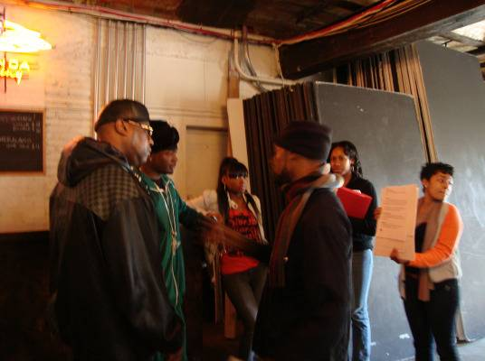 Behind The Scenes - Memphitz looks over script, as DJ Diamond Kuts and Kay Slay listen to Rahman.