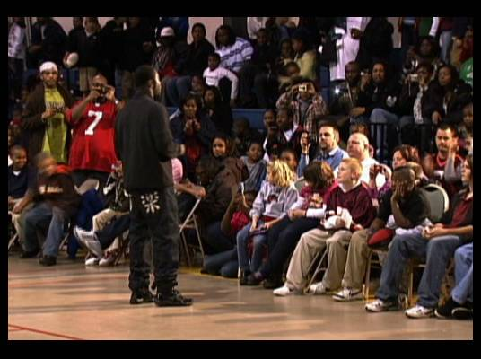 Pop Warner Football - Mike kicks off a fundraiser for the Pop Warner youth football league while a packed gymnasium listens to his speech.