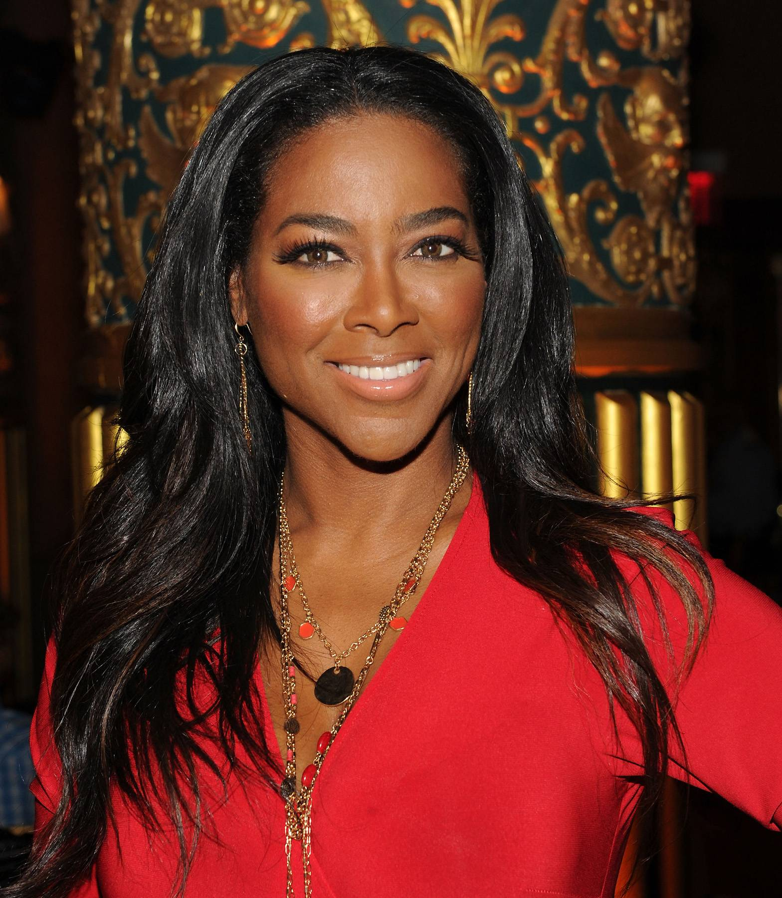 Kenya Moore Attempts to Make Amends - Kenya Moore felt so guilty for canceling an appearance at a Detroit high school twice, that she wrote them a check for $20,000. She made a show of it by posting the photo of herself holding the check on Instagram.  (Photo: Craig Barritt/Getty Images)
