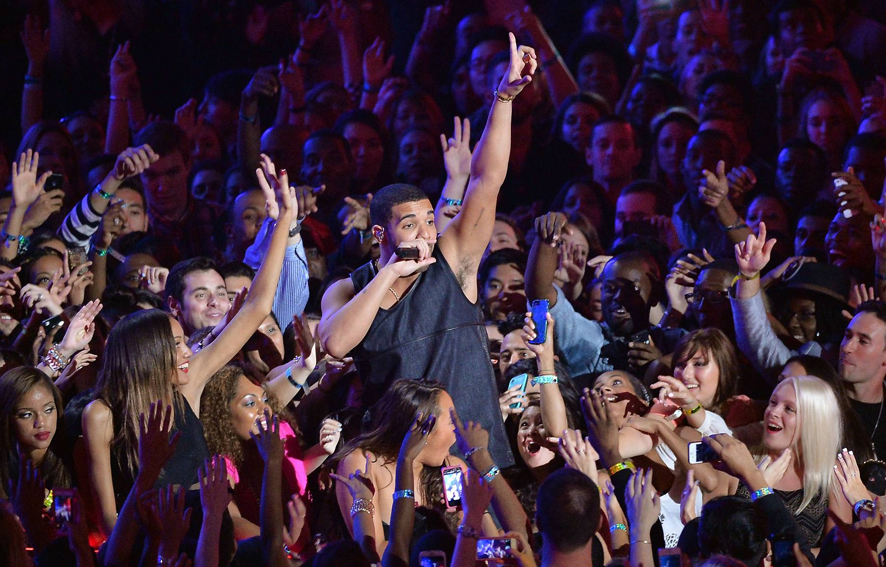 """Drake - A free Drake concert ended before it even began in 2010 at New York's South Street Seaport, when a """"raucous crowd"""" mobbed the scene before Drake even hit the stage. According to fans, it was absolute mayhem as masses of drunk people were pushing to get to the front of the stage, igniting random fist fights throughout the crowd. Not only were fans disappointed when the concert was canceled, Drizzy was sad about it as well. """"I am humbled by the crowd that showed up in support of my performance,"""" he said through his spokeswoman. """"Unfortunately, the show was canceled by the NYPD due to overcrowding, leaving me without the chance to give my fans a real show.""""(Photo: Rick Diamond/Getty Images for MTV)"""