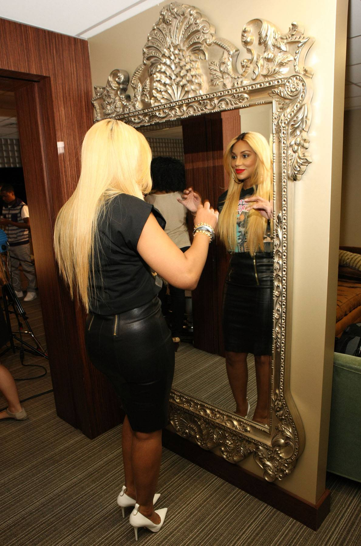 She Looks Good - Tamar does a little mirror check while backstage at 106. (Photo: Bennett Raglin/BET/Getty Images for BET)