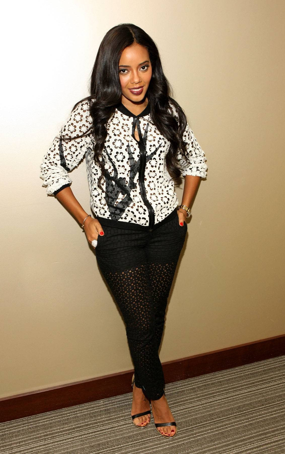 Lotus Flower - Host Angela Simmons wears a black-and-white floral printed shirt on 106. (Photo: Bennett Raglin/BET/Getty Images for BET)