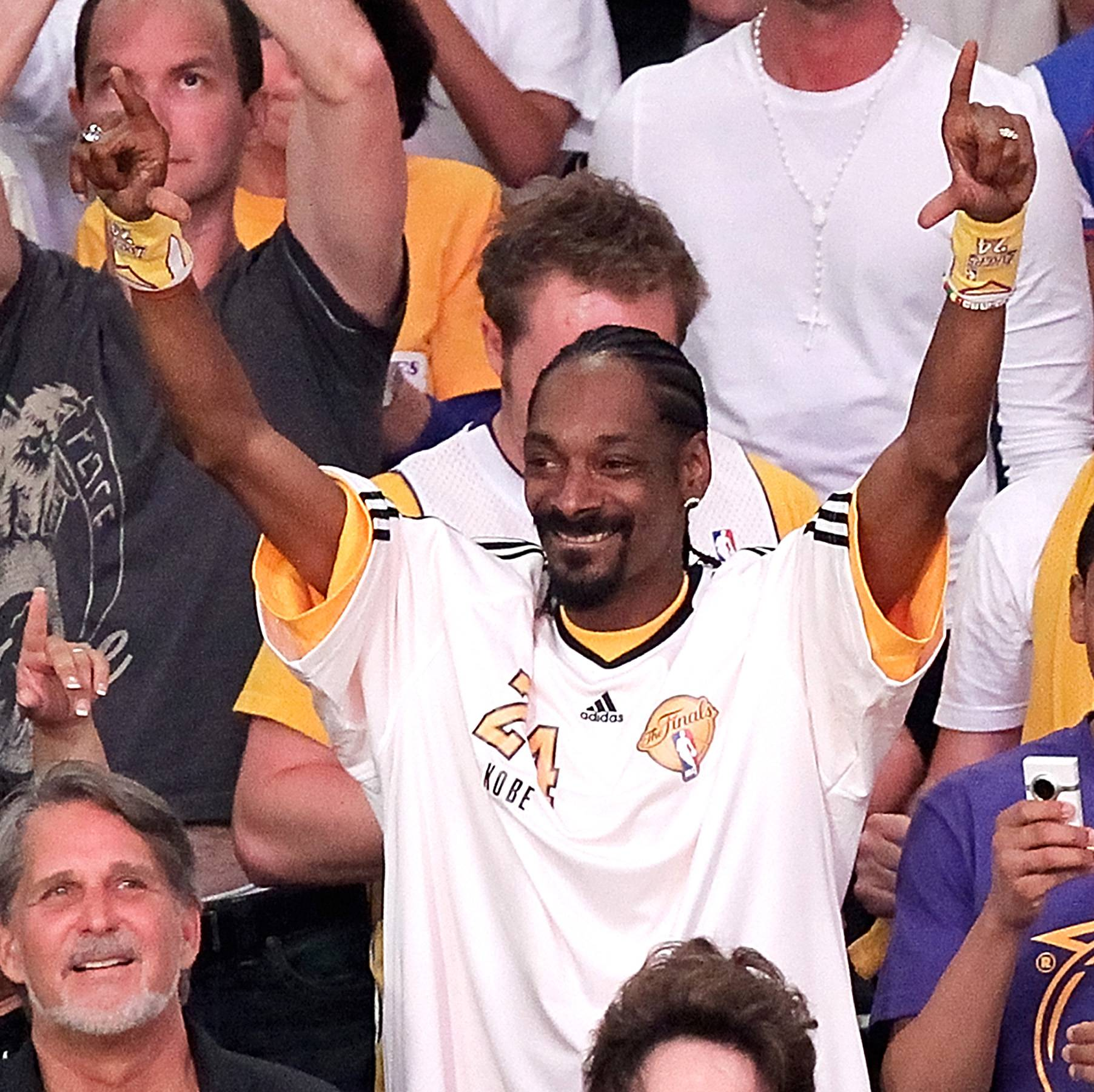 Snoop - Snoop keeps a Lakers reference in his lyrics and on his Twitter. The West Coast repper also designed some purple and yellow-inspired sneakers for Adidas.(Photo: Noel Vasquez/Getty Images)