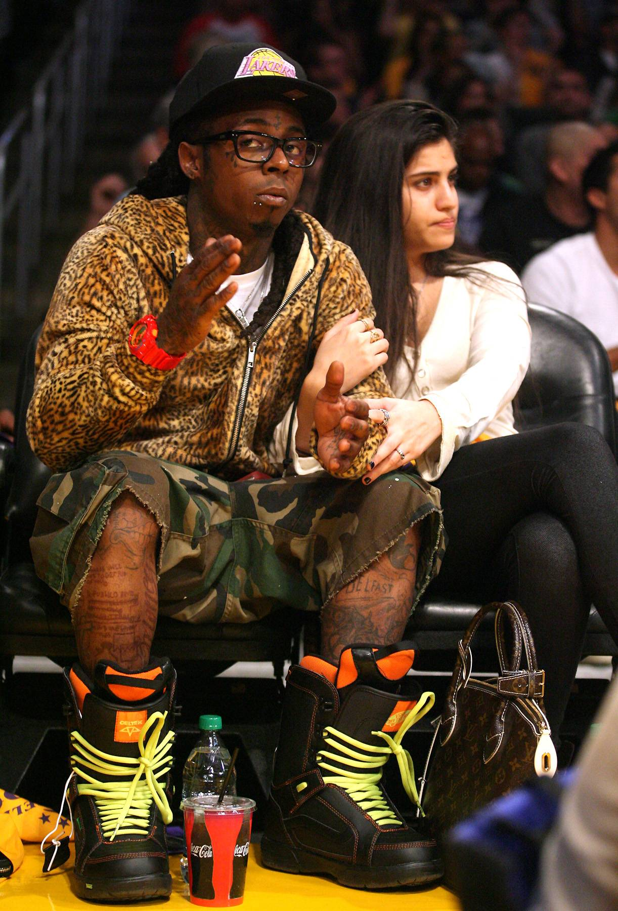 Lil Wayne - The 68th NBA season jumped off Tuesday (Oct. 29) with the defending champs, Miami Heat, continuing their winning ways by beating the Derrick Rose and Chicago Bulls. Lil Wayne is certainly not a Heat fan, but he like many are happy to see the NBA kickoff another season. Weezy, a die hard Los Angeles Lakers fan, is just one of the many music stars who you might see pop up courtside this season. Meanwhile, click on to see who else likes to post up in jerseys, sit courtside and trash-talk on Twitter.(Photo: London Entertainment / Splash News)