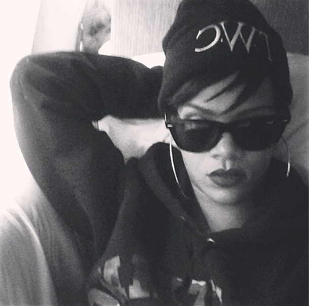Beanie, Baby - They?re not just for bad hair days anymore! Beanies with white lettering are big with disciples of the ghetto goth style. Rih plays hers up with enormous hoop earrings and a graphic print hoodie.  (Photo: Rihanna via Instagram)