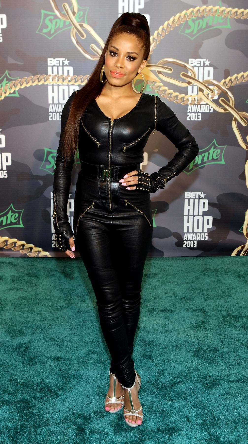 Keshia Chanté - 106 & Park's new host, Keshia Chanté, stuns in a black jumpsuit, black gloves and killer shoegame. She, too, proves that gold is back on trend, as her 'fit included hints of gold throughout. (Photo: Bennett Raglin/BET/Getty Images for BET)