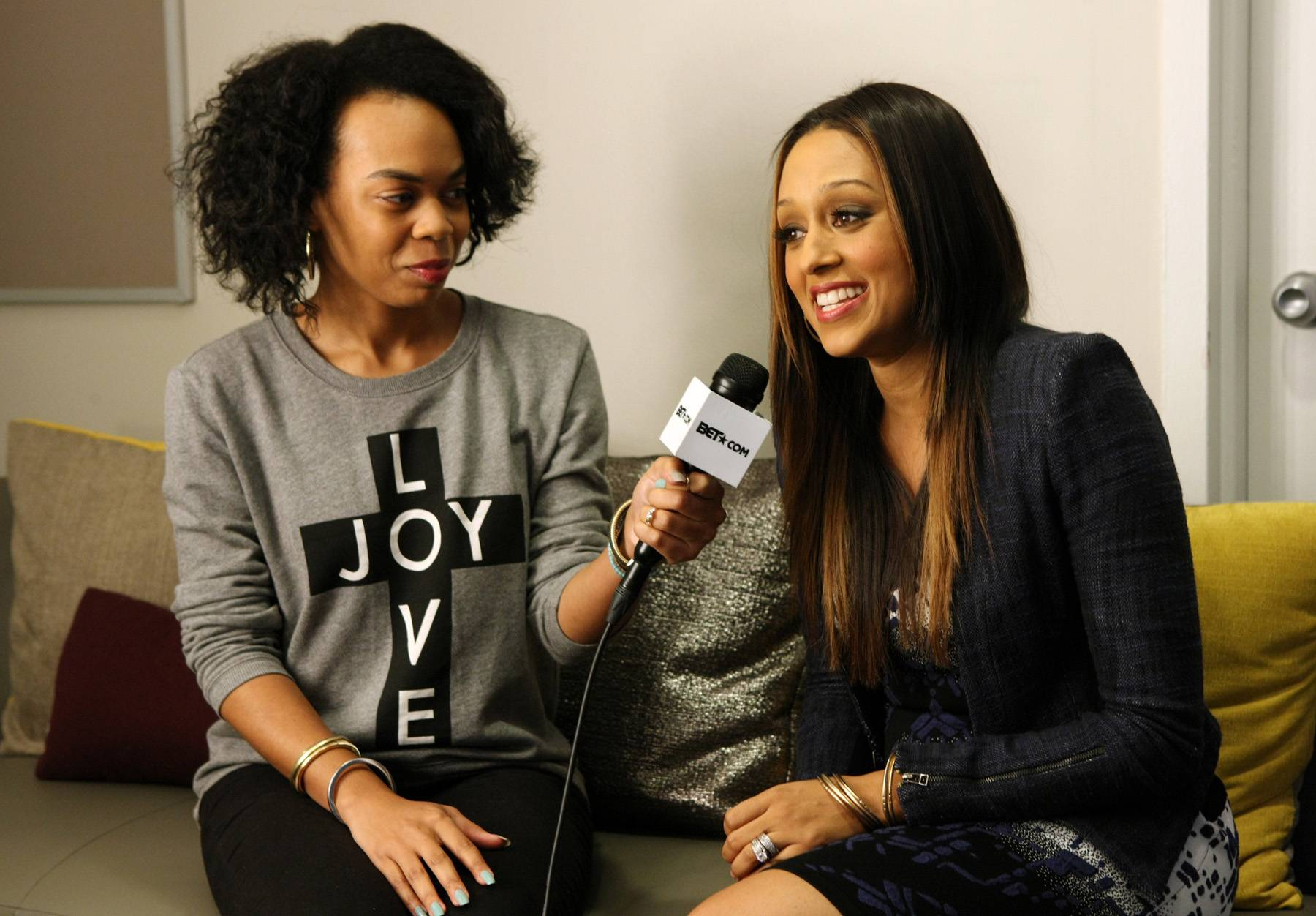 All Access - Actress Tia Mowry-Hardrict backstage at 106 with BET.com's Taj Rani. (Photo: Bennett Raglin/BET/Getty Images for BET)