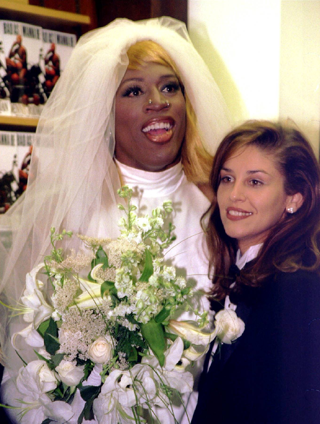 Fashion Foward - Rodman's fashion choices have always been a little out there (facial piercings and hair colors spanning the rainbow included), but nothing quite topped the wedding dress and blonde wig he wore during the press tour for his 1996 autobiography,Bad As I Wanna Be.(Photo: REUTERS/Peter Morgan/Files /Landov)