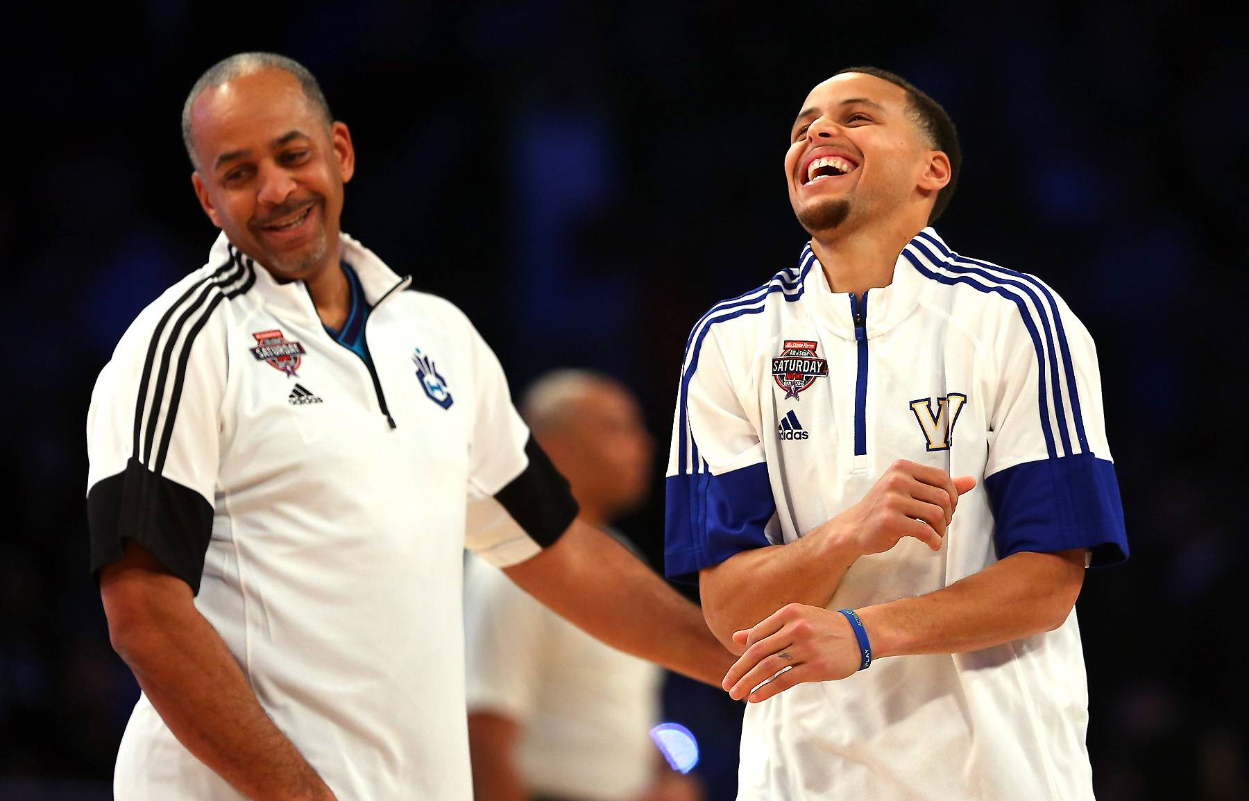 Curry With the Shot  - These two NBA stars have more in common than just kinship. Stephen Curry, No. 30 of the Golden State Warriors, and his father NBA Legend Dell Curry are both basketball stars. (Photo: Elsa/Getty Images)