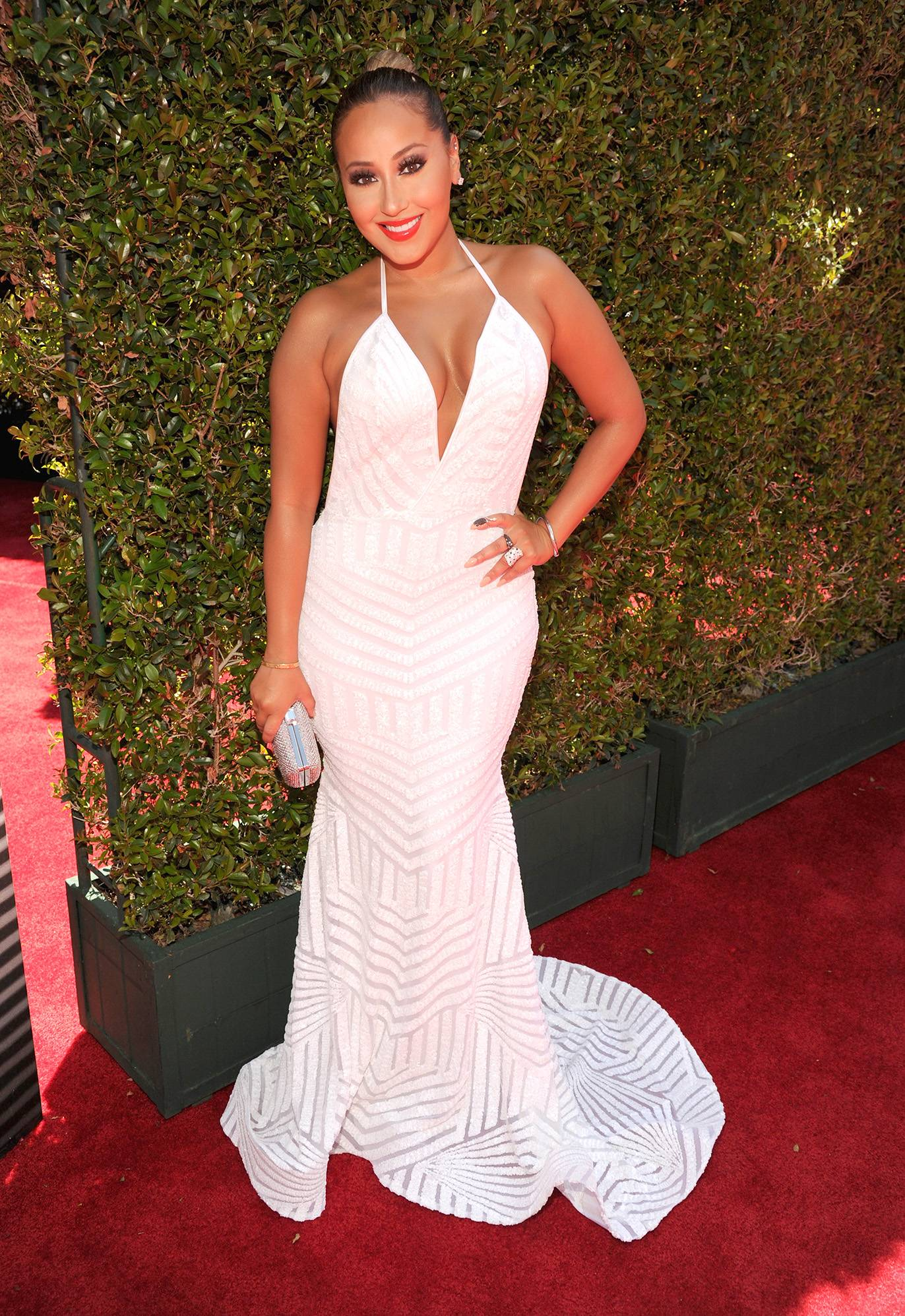 Adrienne Bailon - The actress and TV host is always a stunner and even more so in this white Michael Costello halter gown with a mermaid train. (Photo: Kevin Mazur/BET/Getty Images for BET)