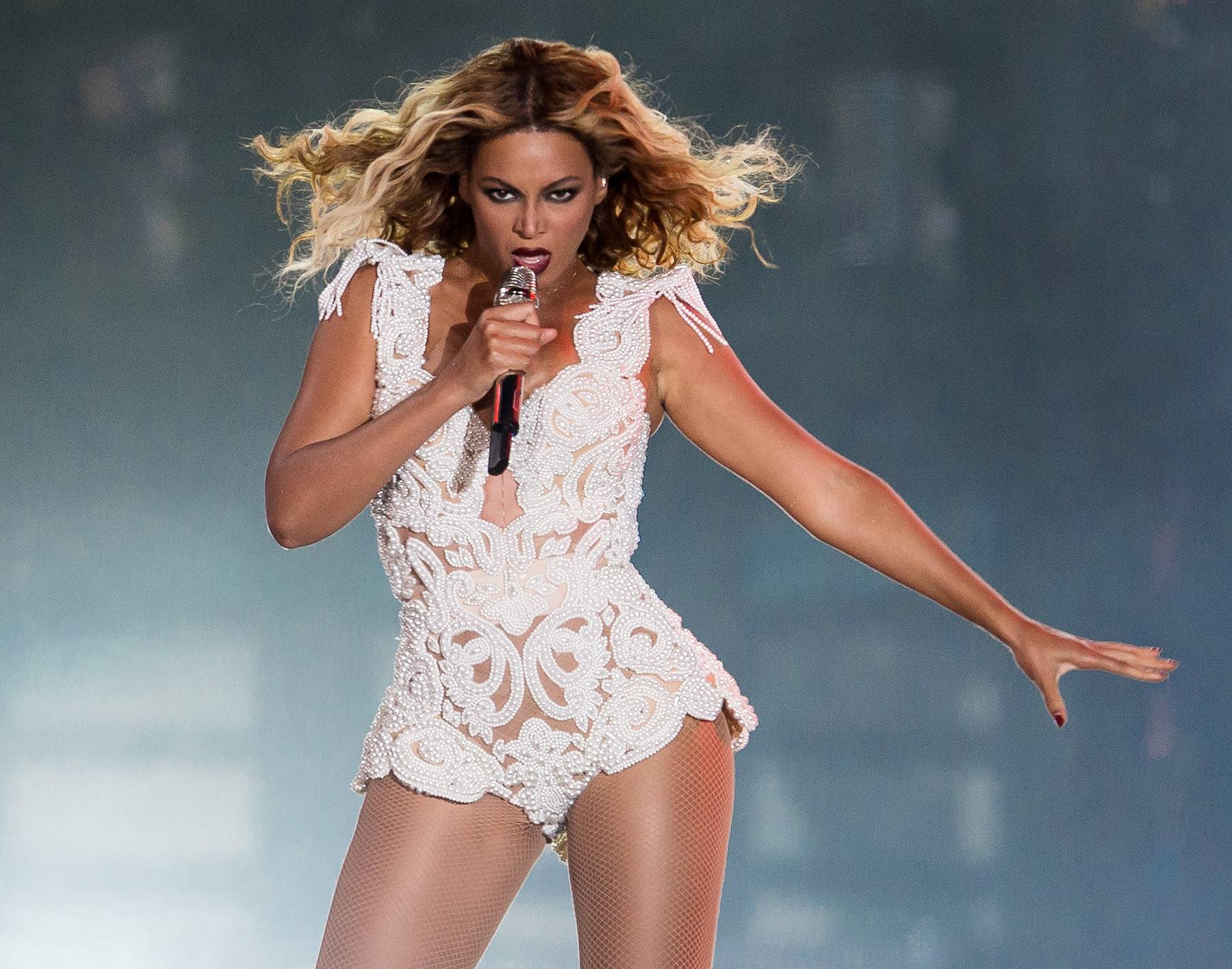 Body Snatcher - When Beyonc? reached into the audience to touch someone in the crowd in Sao Paulo, Brazil, she got more than she bargained for. One overzealous, shirtless fanatic took hold of her with a two-armed hug and pulled her off the stage. (She never stopped singing, though.)(Photo: Buda Mendes/Getty Images)