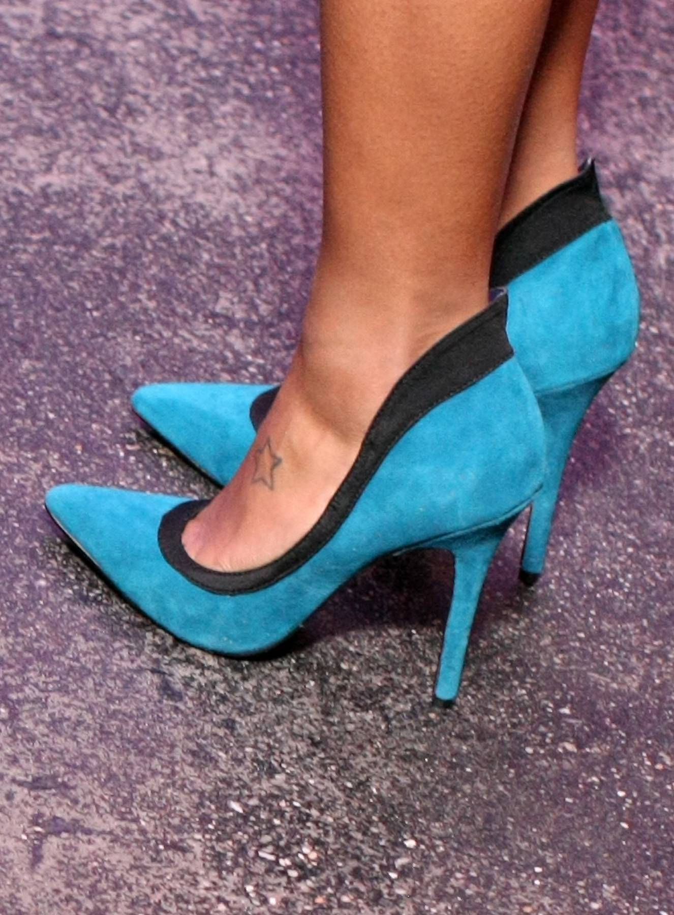 A Touch of Blue - Angela Simmons shows off a splash of color and looks liek a bawse in these blue shoes backstage on 106. (Photo: Bennett Raglin/BET/Getty Images for BET)