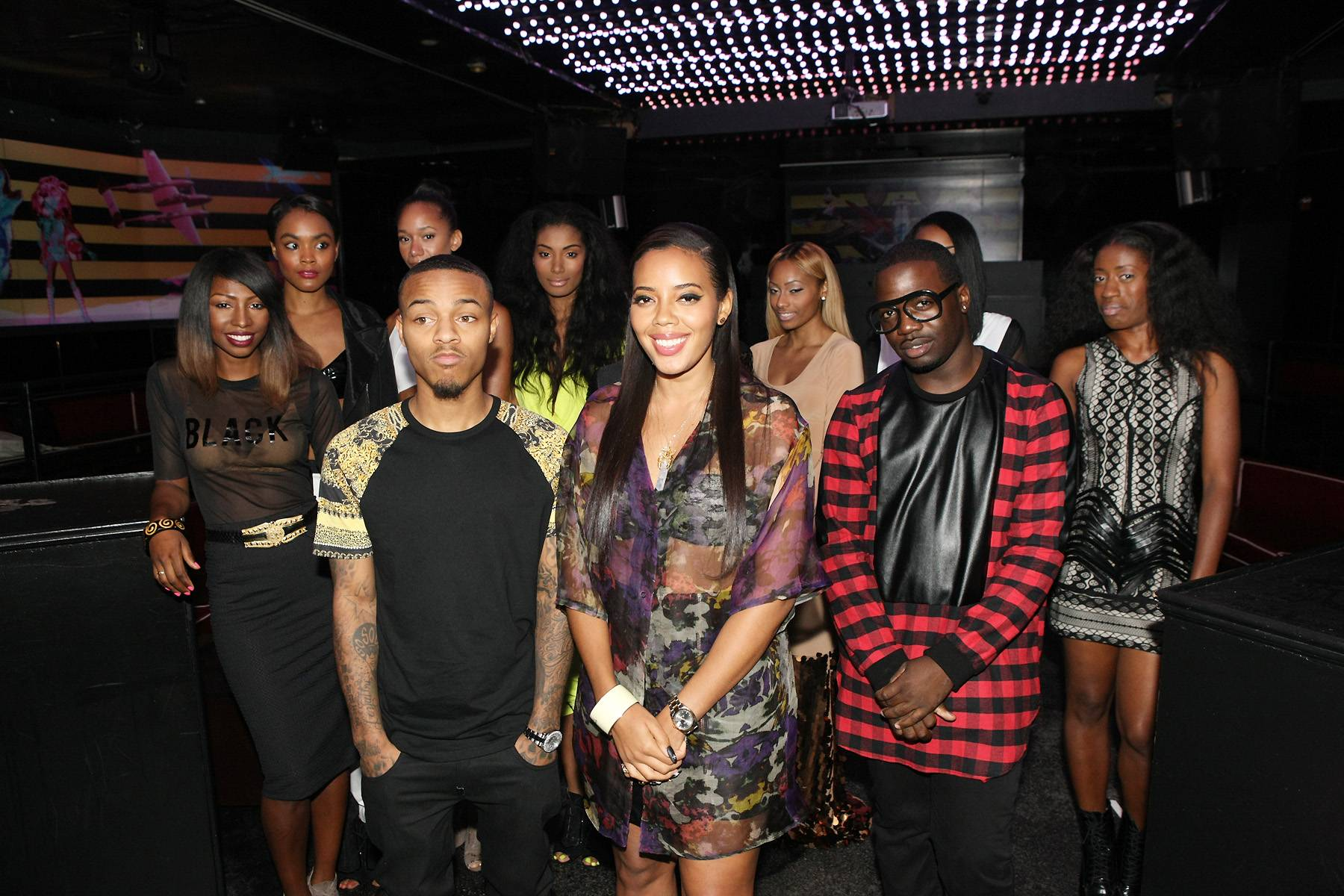 Flare for Fashion - Hosts Bow Wow and Angela Simmons take a fashionable pic with all of our designers. (Photo: Bennett Raglin/BET/Getty Images for BET)