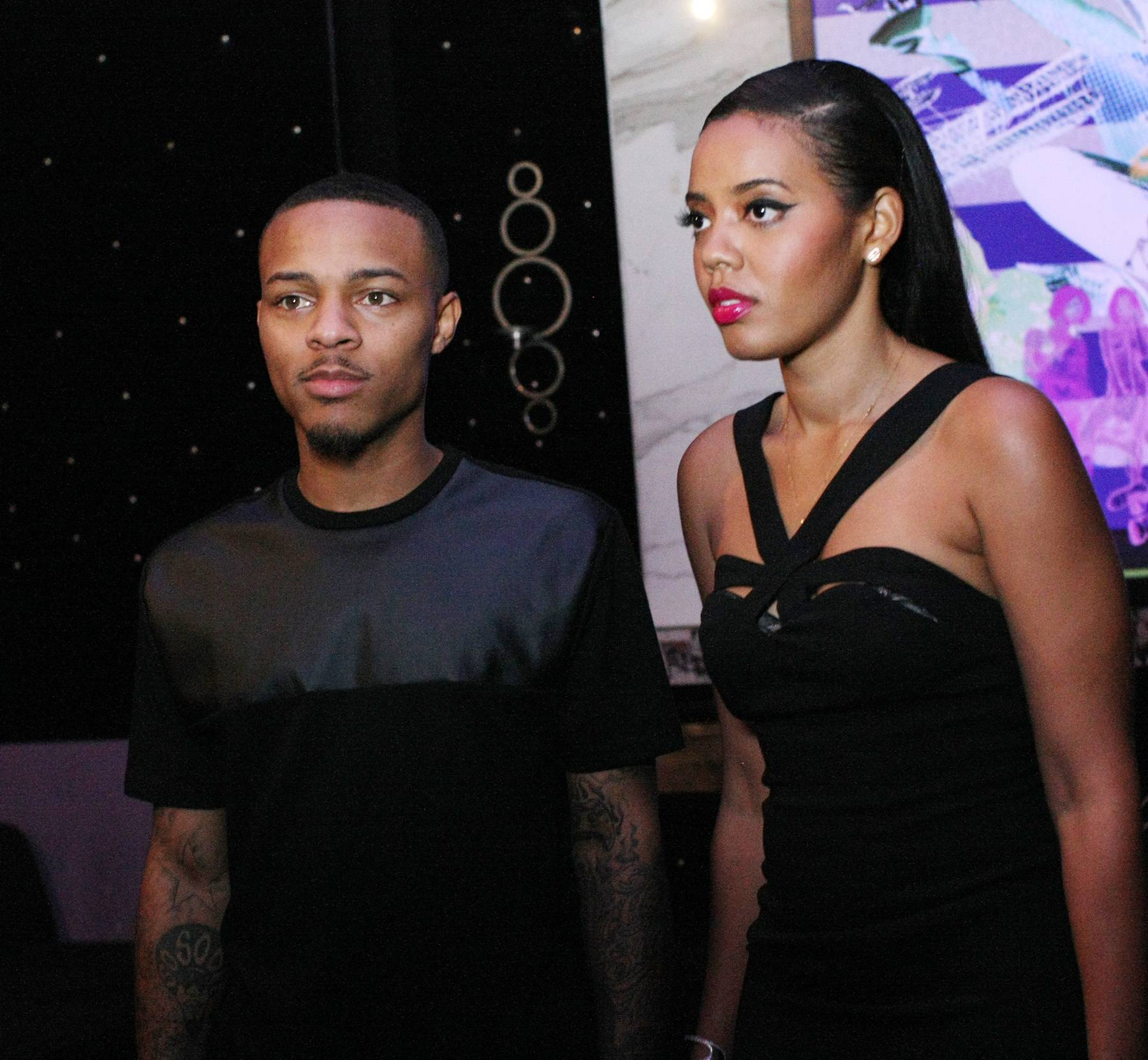 Focused - Hosts Angela Simmons and Bow Wow pay close attention for what to do next.(Photo: Bennett Raglin/BET/Getty Images for BET)