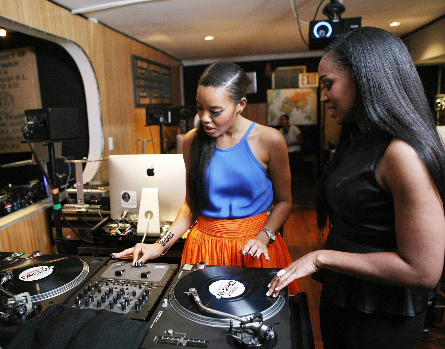 Girl Power - DJ Steele teaches host Angela Simmons what to do behind the turntables on 106.(Photo: Bennett Raglin/BET/Getty Images for BET)