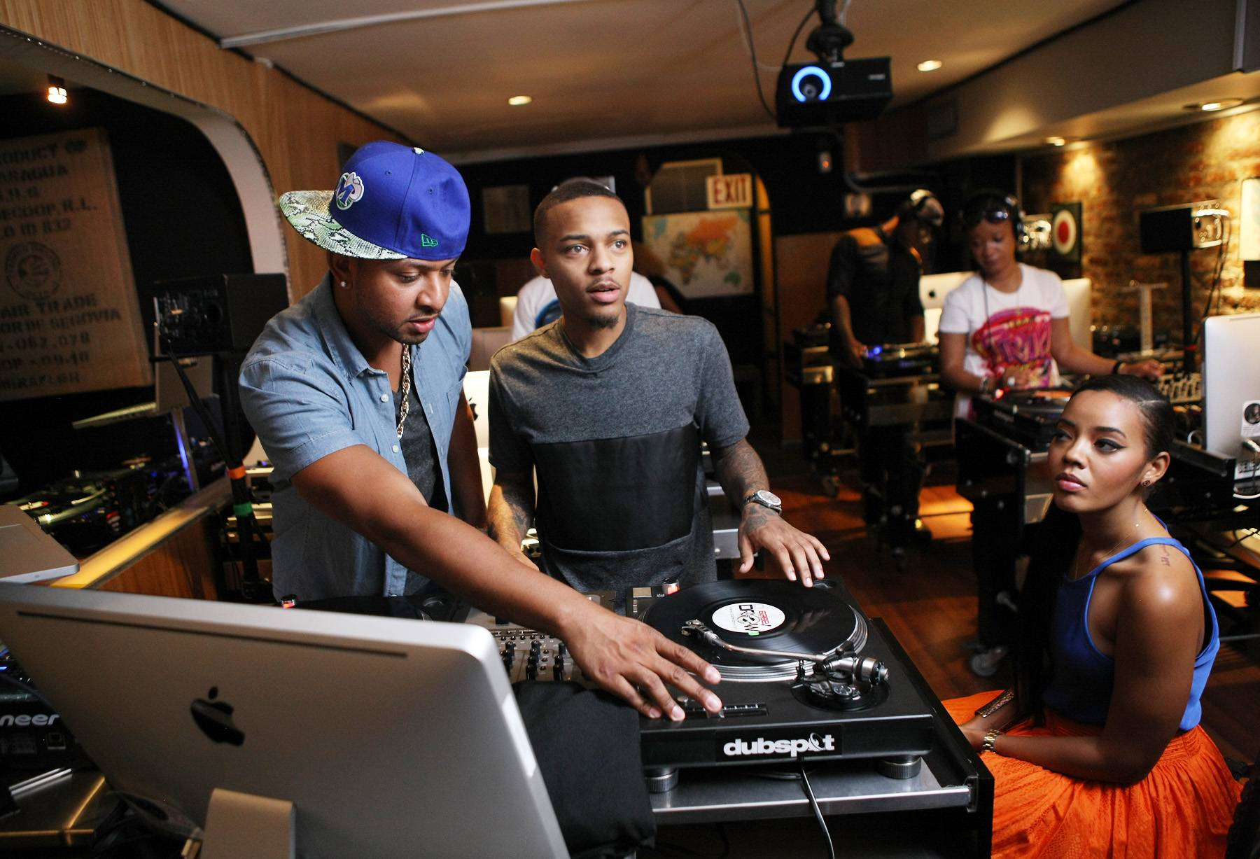 Class in Session - Bow Wow and Angela Simmons pay close attention while DJ Babey Drew shows them how to work with the 1s and 2s.(Photo: Bennett Raglin/BET/Getty Images for BET)