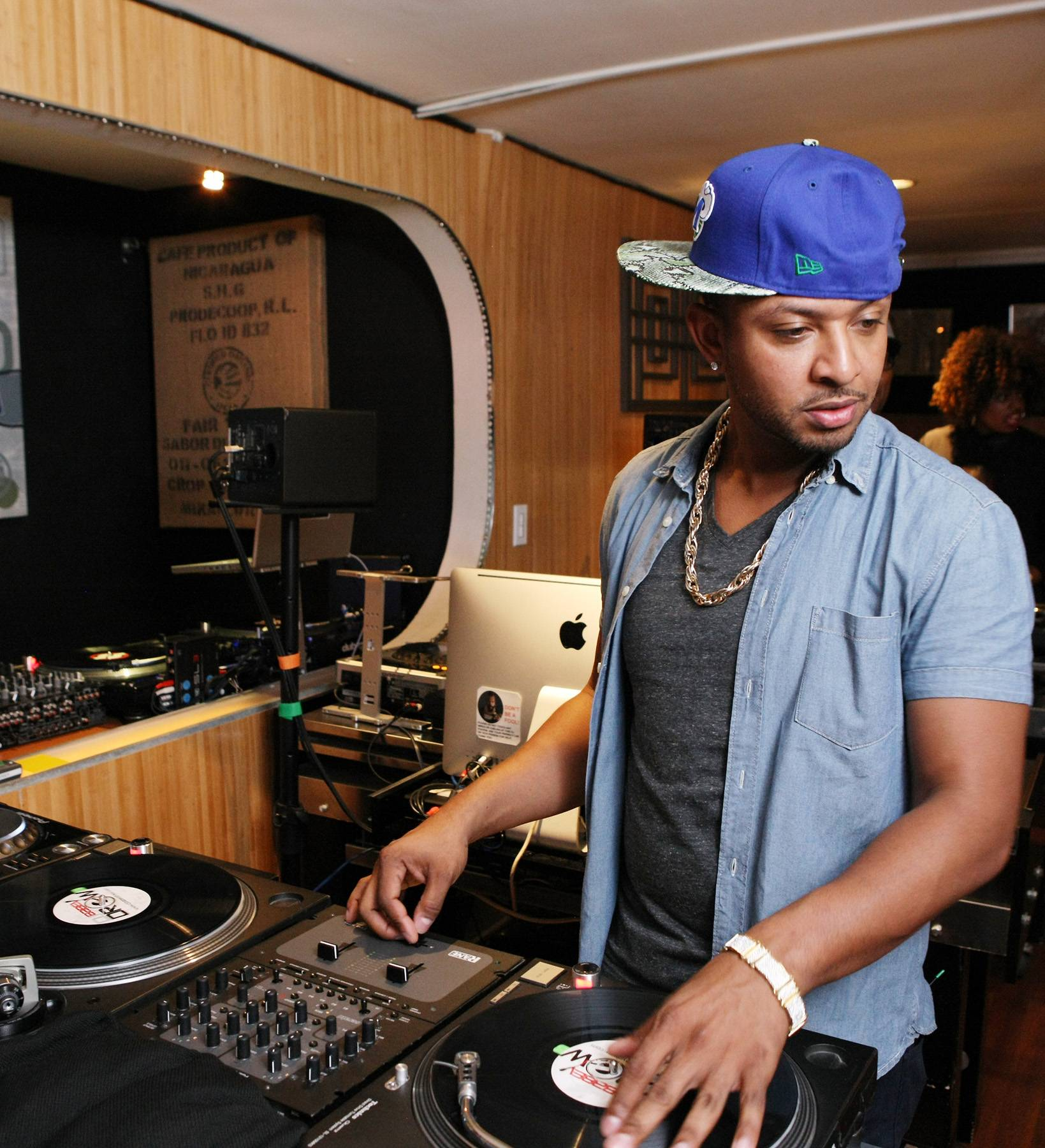 1s and 2s - DJ Babey Drew guides the hosts in how to be scratch masters. (Photo: Bennett Raglin/BET/Getty Images for BET)