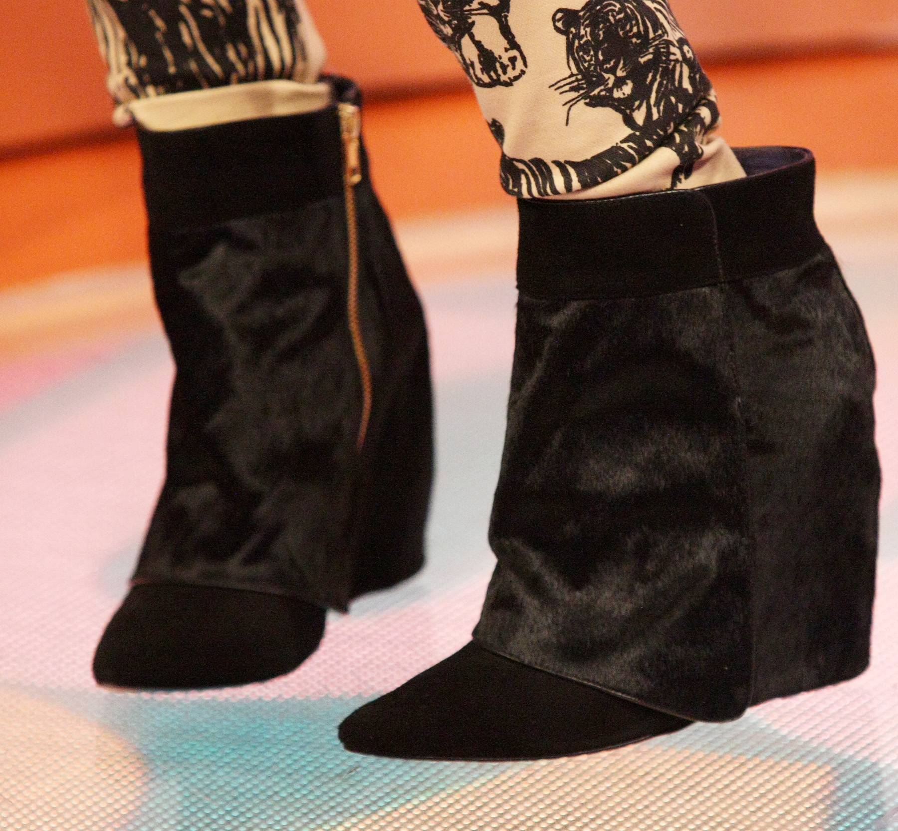 Leg Warmers - Angela Simmons rocks some boots that look pretty warm while on the set of 106. (Photo: Bennett Raglin/BET/Getty Images for BET)