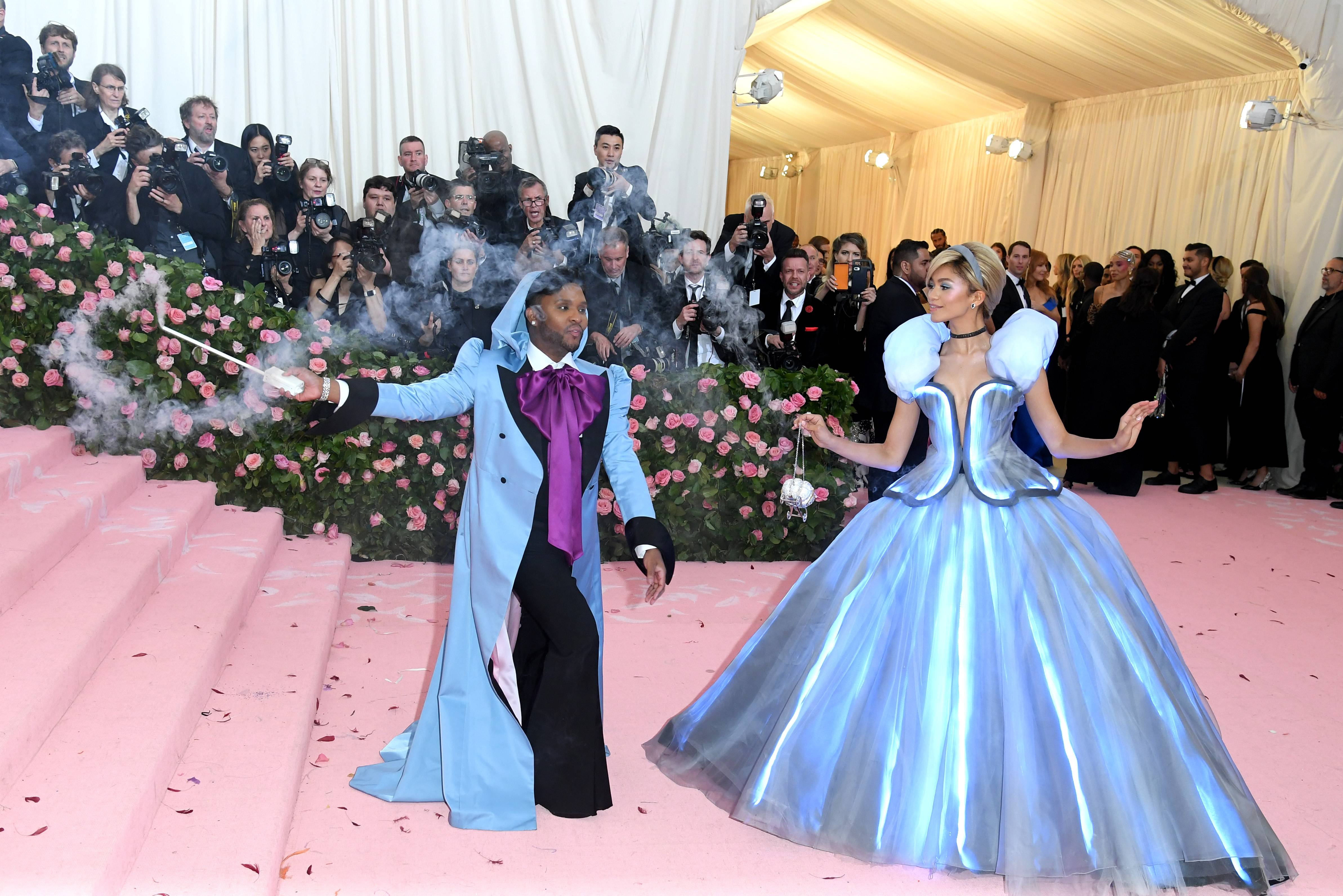 Princess Zendaya - Our girl Z has slowly become known to nail the MET Gala themes and the 2019 'Camp' theme was no different. Not only did she arrive in a custom Tommy Hilfiger gown looking like a brown Cinderella, with stylist Law Roach as her fairy god muva, Zendaya even left a glass slipper on the steps while carrying a customJudith LeiberSwarovski crystal-embellished, Cinderella carriage clutch purse. We are here for the theatrics!(Photo: John Shearer/Getty Images for THR)