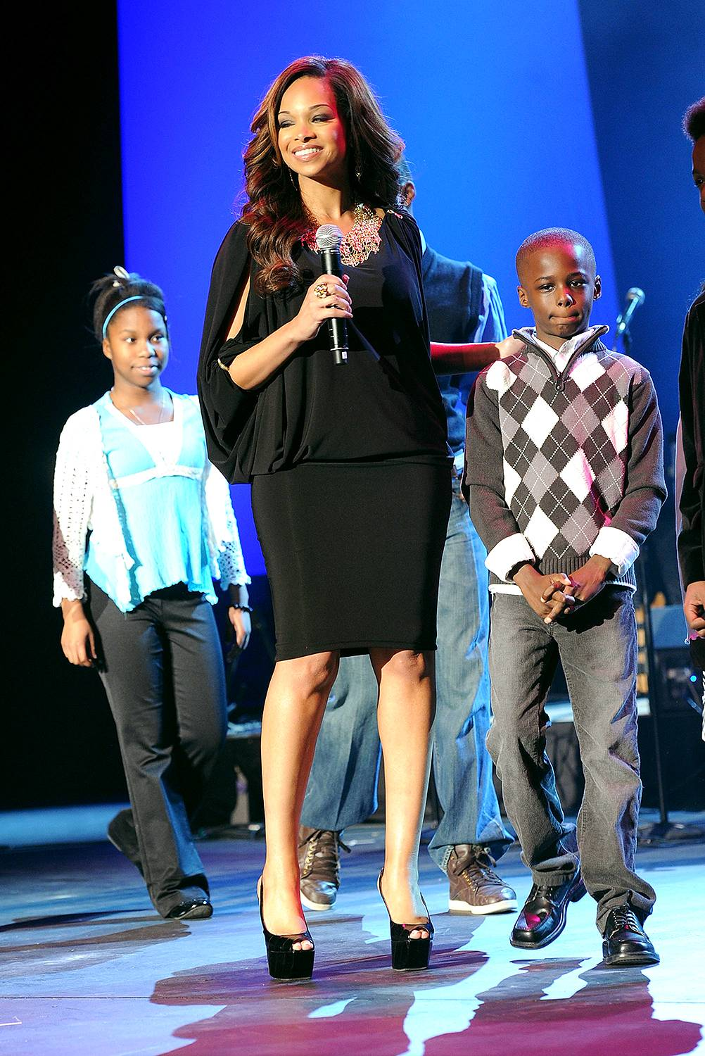 Love Like Christ - Pat Smith and her children take the stage during the Super Bowl Gospel Celebration 2011 at Music Hall At Fair Park in Dallas.(Photo: Rick Diamond/Getty Images for Super Bowl Gospel Celebration 2011)