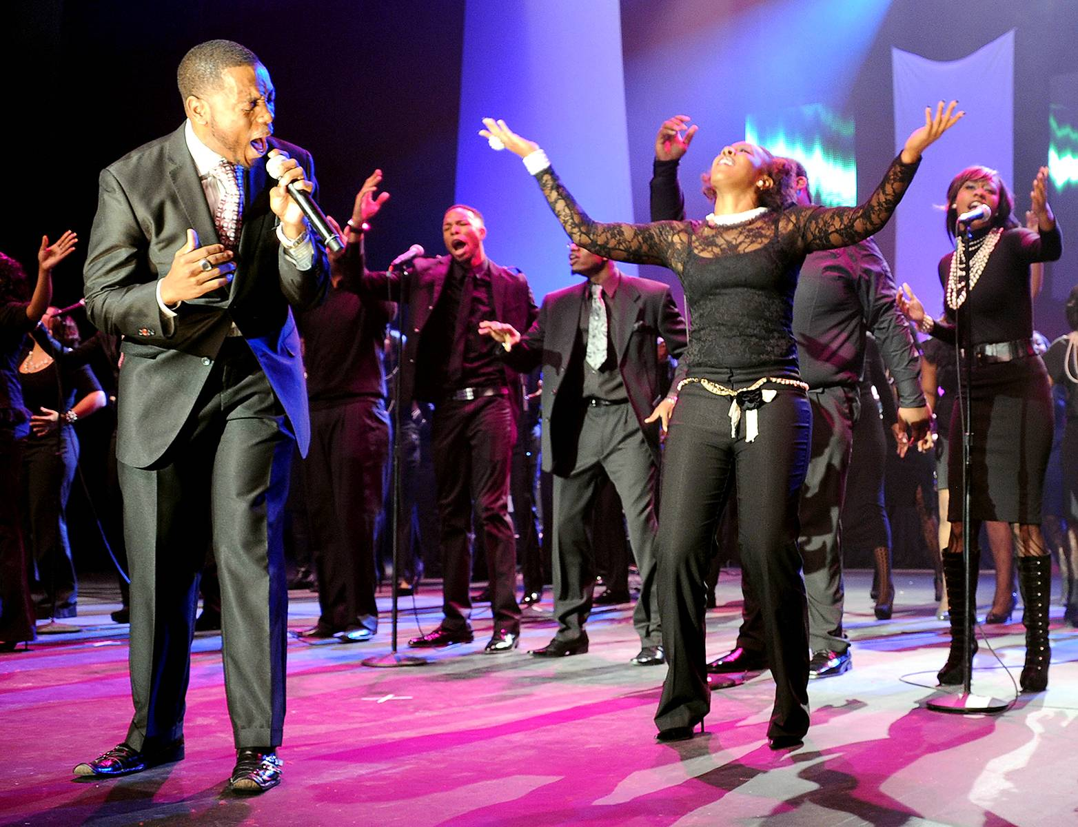 """Live Your Destiny - Reverend Michael J. Fisher and Voices of Destiny Choir,the 2010winner of Verizon's """"How Sweet the Sound"""" competition, perform during the Super Bowl Gospel Celebration 2011 at Music Hall at Fair Park in Dallas.(Photo: Rick Diamond/Getty Images for Super Bowl Gospel Celebration 2011)"""