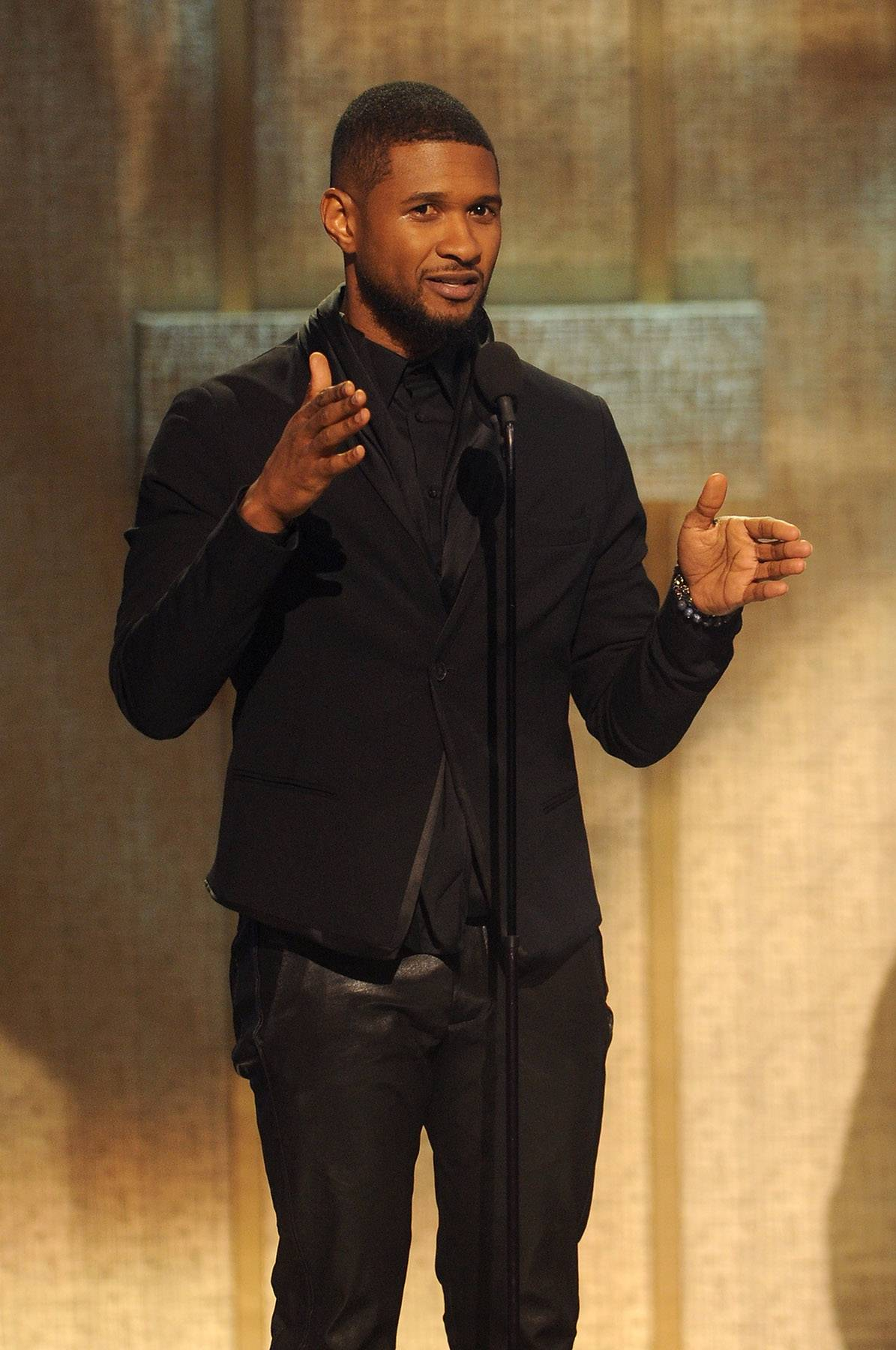 Honoring Others - The BET Honors Musical Arts honoreeUsheraccepts his award by saluting the rest of the BET Honors honorees.(Photo: Brad Barket/BET/Getty Images for BET)
