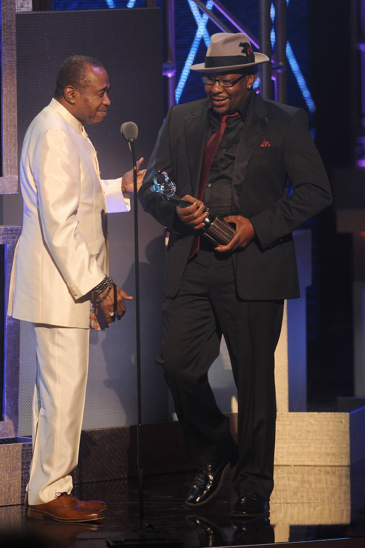 Inspirational Moments  - Actor Ben Vereen and New Edition frontman Bobby Brown present Usher with the award for Musical Arts.(Photo:Brad Barket/BET/Getty Images for BET)