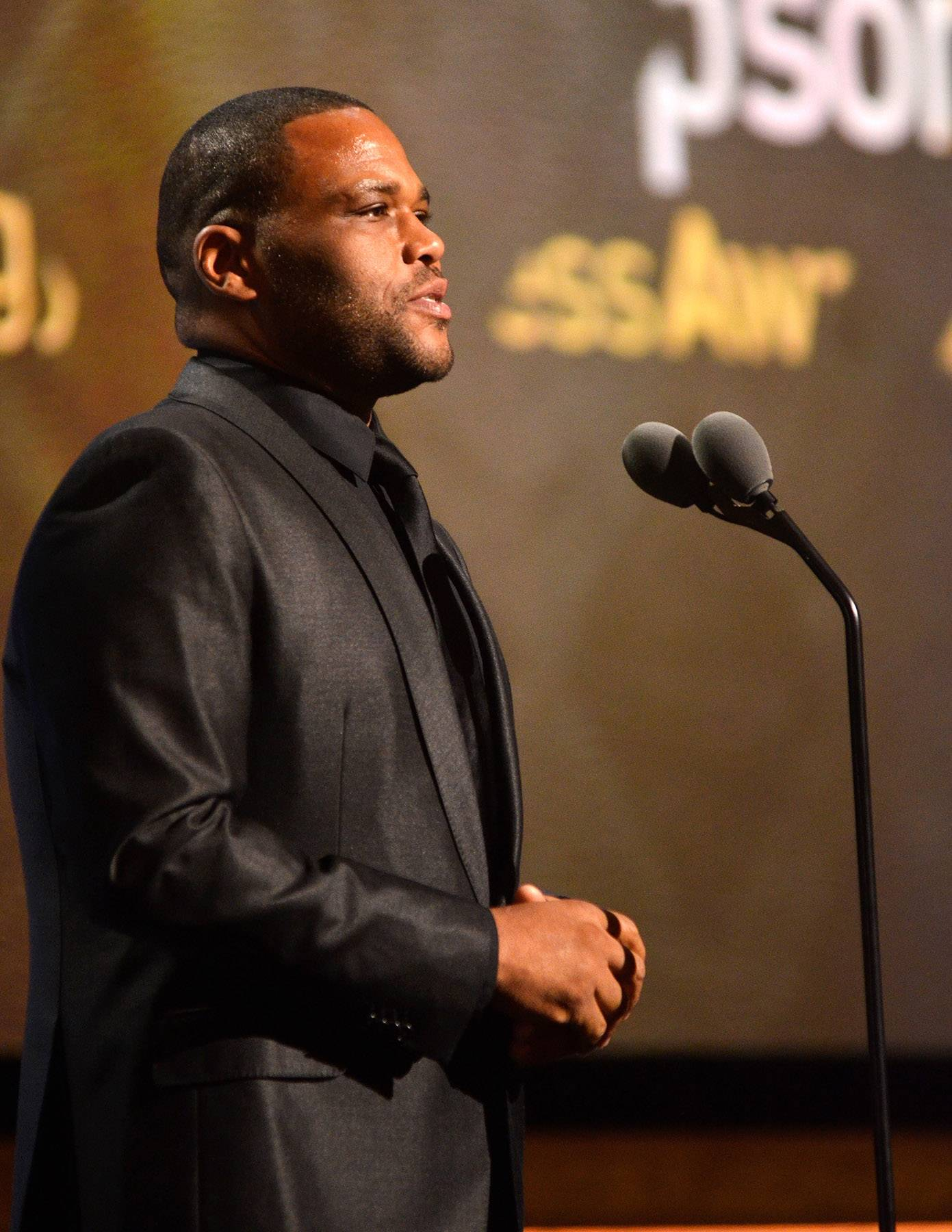 Introducing Mr. Thompson  - Actor Anthony Anderson introduces BET HonorsTechnology and Business Award recipientJohn W. Thompson, CEO of privately held Virtual Instruments and the Chairman of Microsoft Corporation. (Photo: Kris Connor/BET/Getty Images for BET)