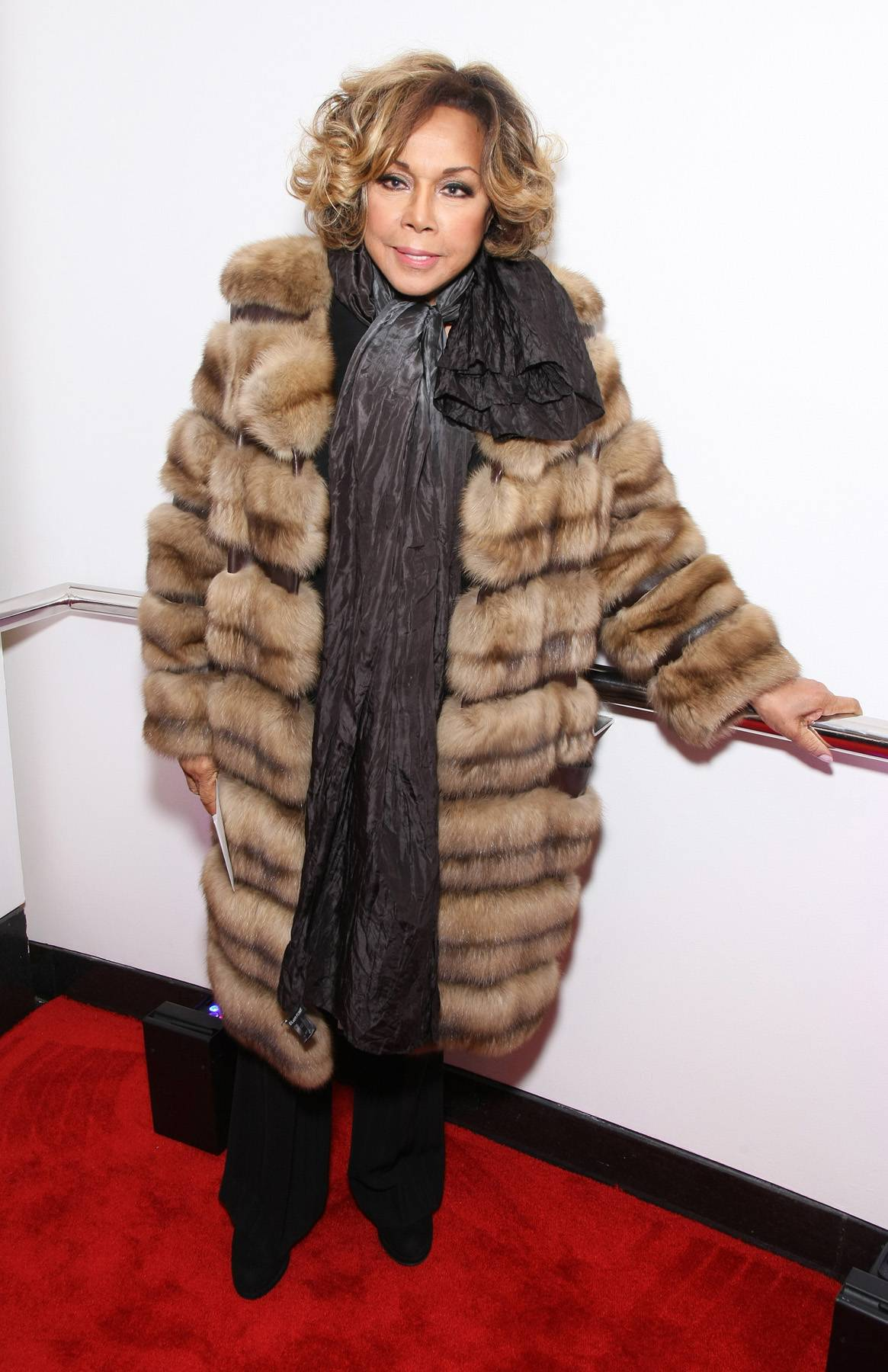 Royal Dynasty - Actress Diahann Carroll steps out on the carpet with her fur coat looking like she stepped right out of a scene from Dynasty. (Photo: Bennett Raglin/BET/Getty Images for BET)