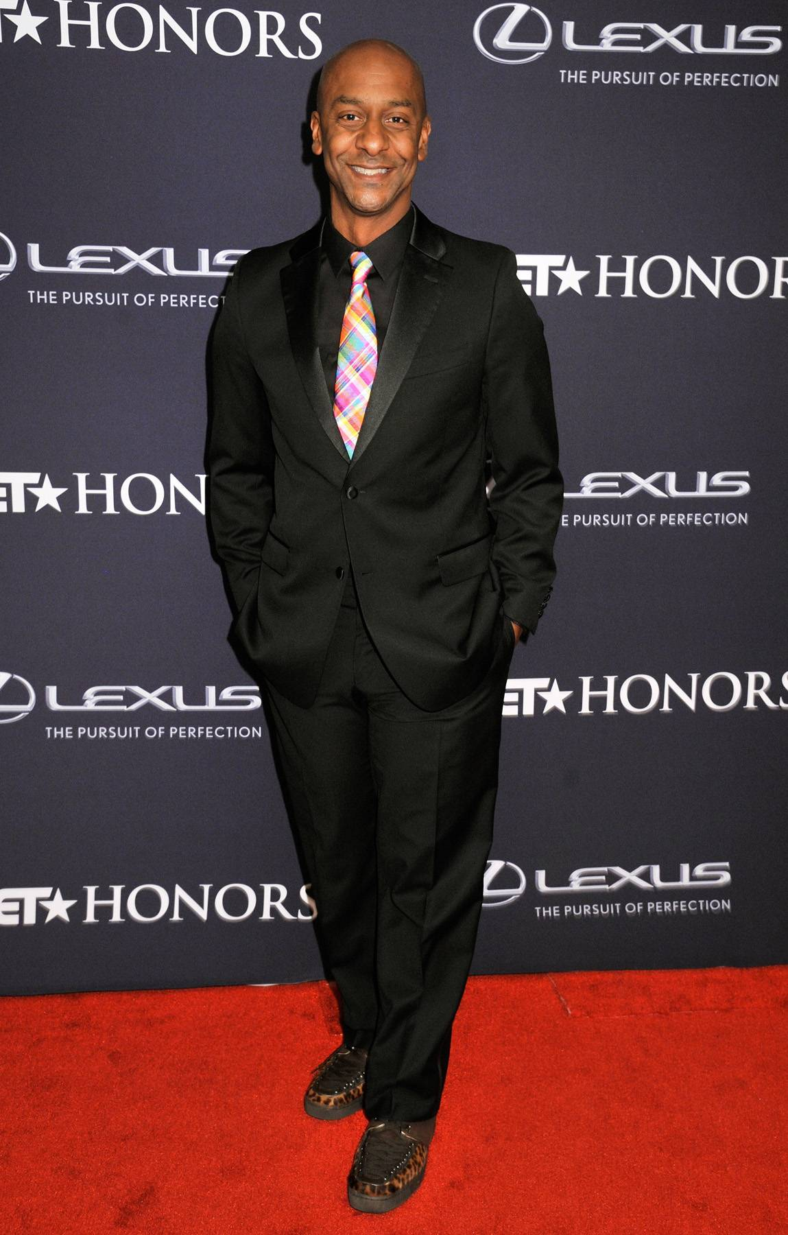 Stay Tuned In  - Stephen Hill,president of programming for BET,is camera ready as he hits the carpet for The BET Honors 2015 ceremony. (Photo: Kris Connor/BET/Getty Images for BET)