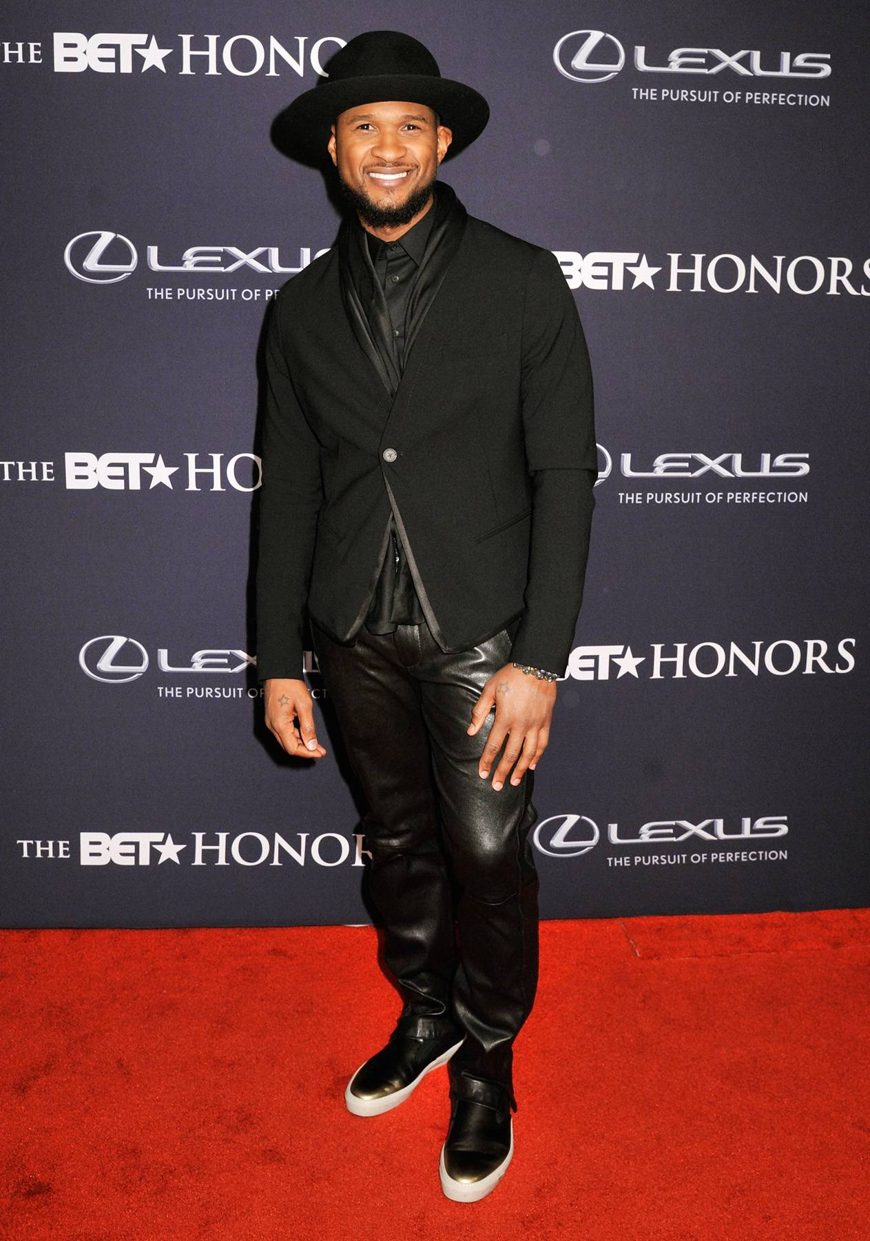 THE UR Experience  - The BET Honors Musical Award winnerUsher keeps it casual but fashionable. The hat is the key accessory that adds a stylish flair to the ensemble. (Photo:Kris Connor/BET/Getty Images for BET)