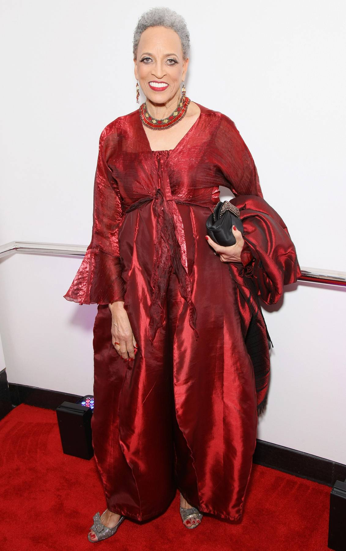 Crimson and Clean  - The BET Honors Education Award winner Dr. Johnnetta B. Cole glides across the red carpet in her royal crimson jumpsuit. (Photo: Bennett Raglin/BET/Getty Images for BET)