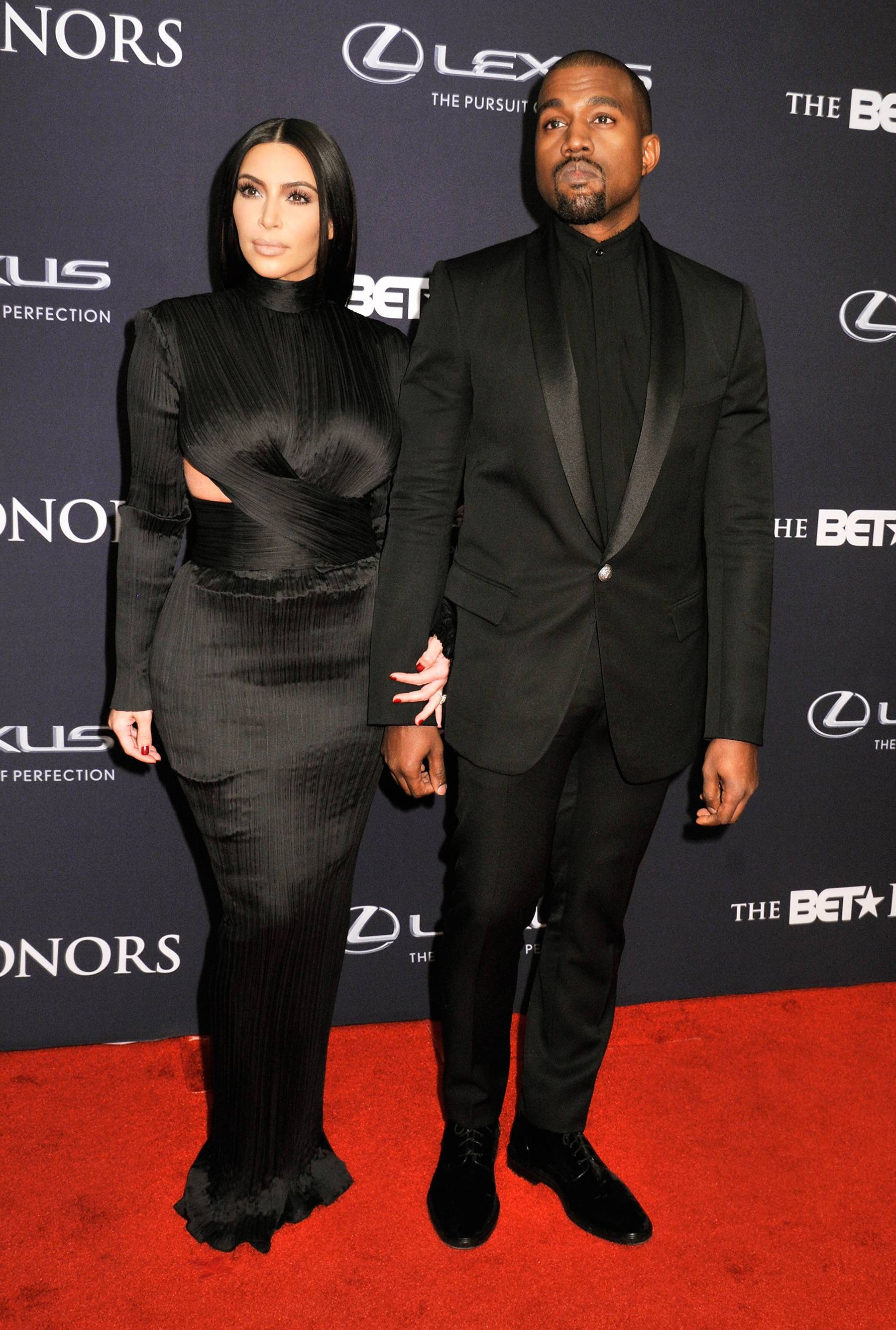 """Award-Winning Couple - Kim Kardashian and The BET Honors Visionary Award winner Kanye West slay from head to toe in black. Kim K and Yeezy make """"stunning"""" look so easy. (Photo: Kris Connor/BET/Getty Images for BET)"""
