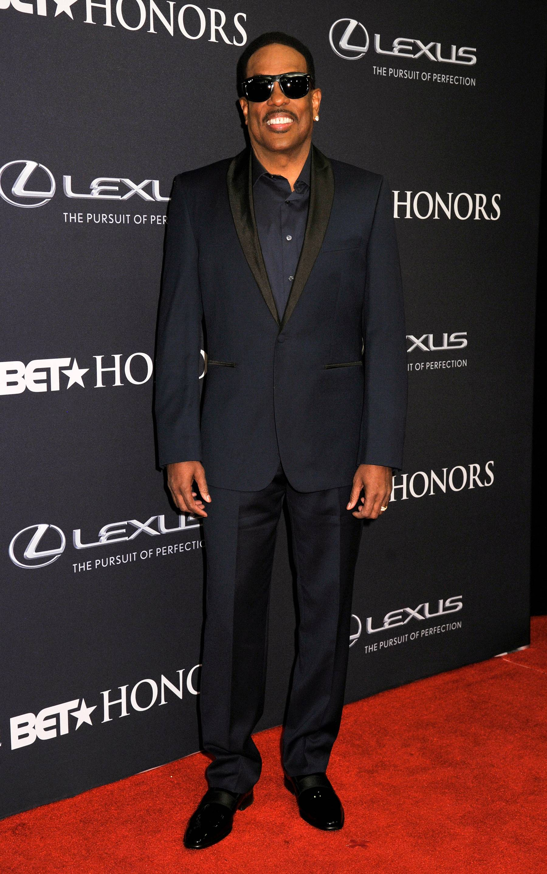 Charlie, Last Name Wilson  - Singer Charlie Wilson is suited up in his black-tie affair wear for the The BET Honors 2015 ceremony. (Photo: Kris Connor/BET/Getty Images for BET)