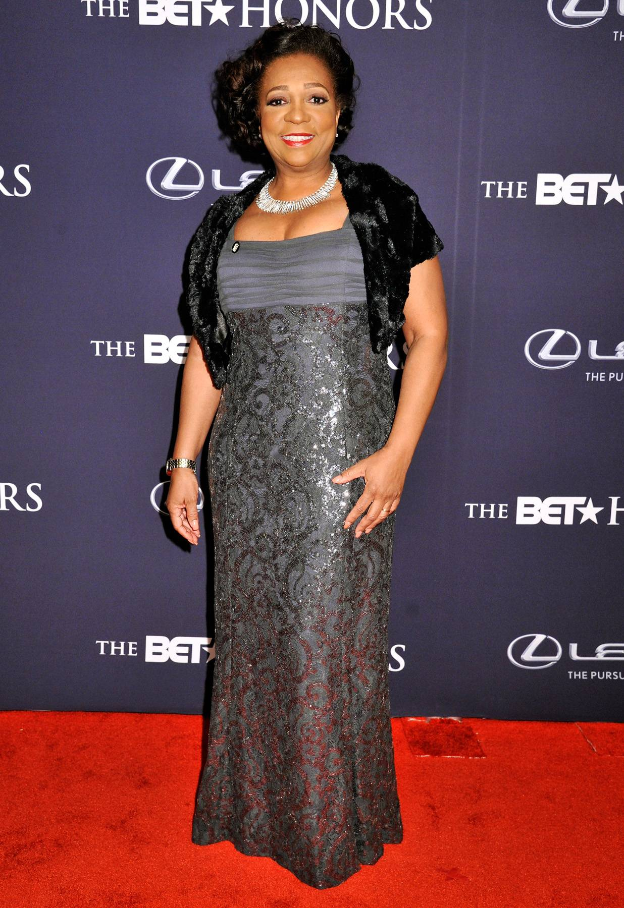 Classy and Sassy  - BET's Vice President of SpecialsLynne Harris Taylor is styled in a classy floor-length gown. (Photo: Kris Connor/BET/Getty Images for BET)