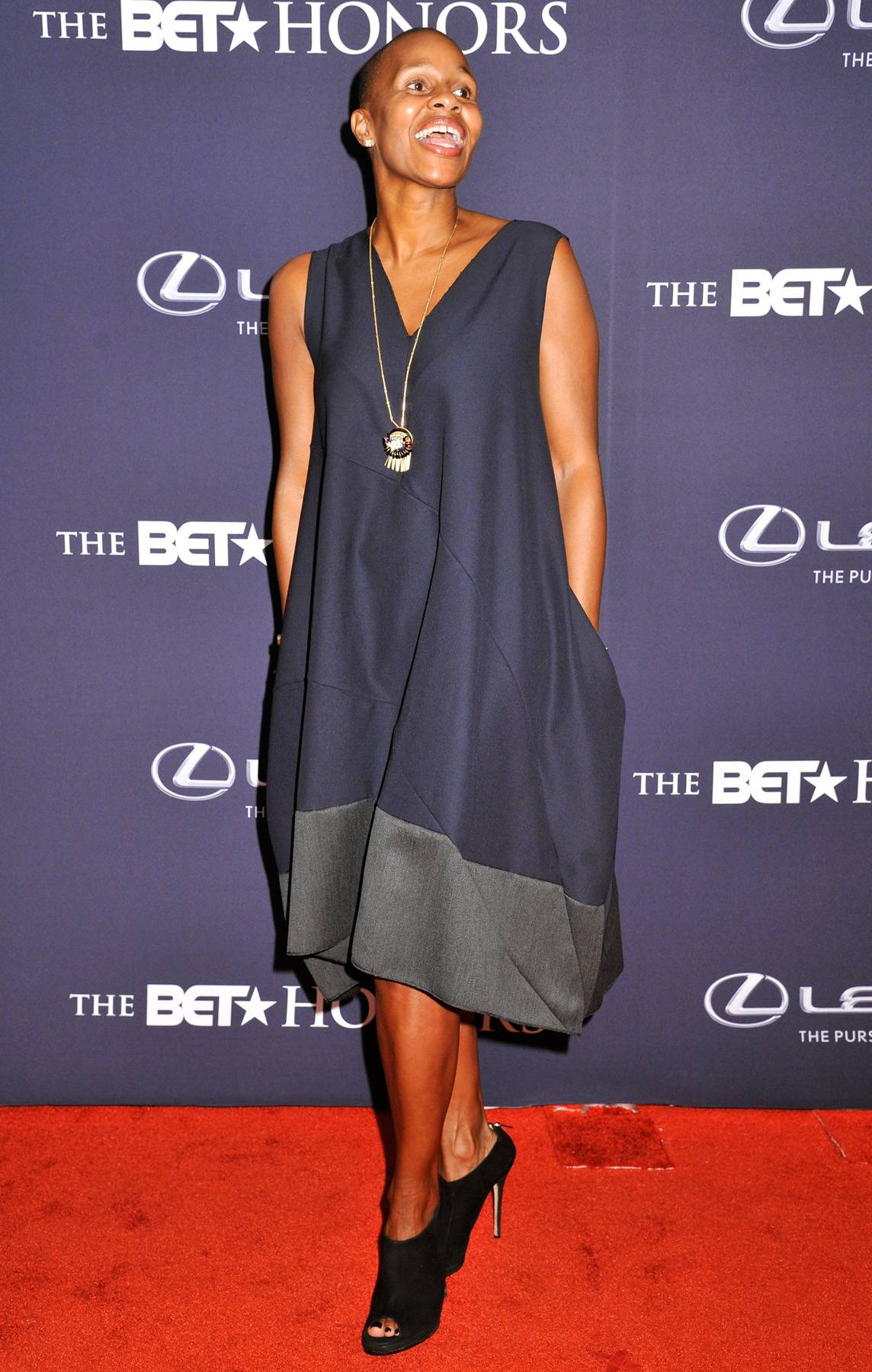Bright and Beautiful  - Executive Vice President of Corporate Communications and Corporate Social Responsibility for BET NetworksJeanine Liburdadds a bright and beautiful elegance to the carpet in her chic free-flowing dress. (Photo: Kris Connor/BET/Getty Images for BET)