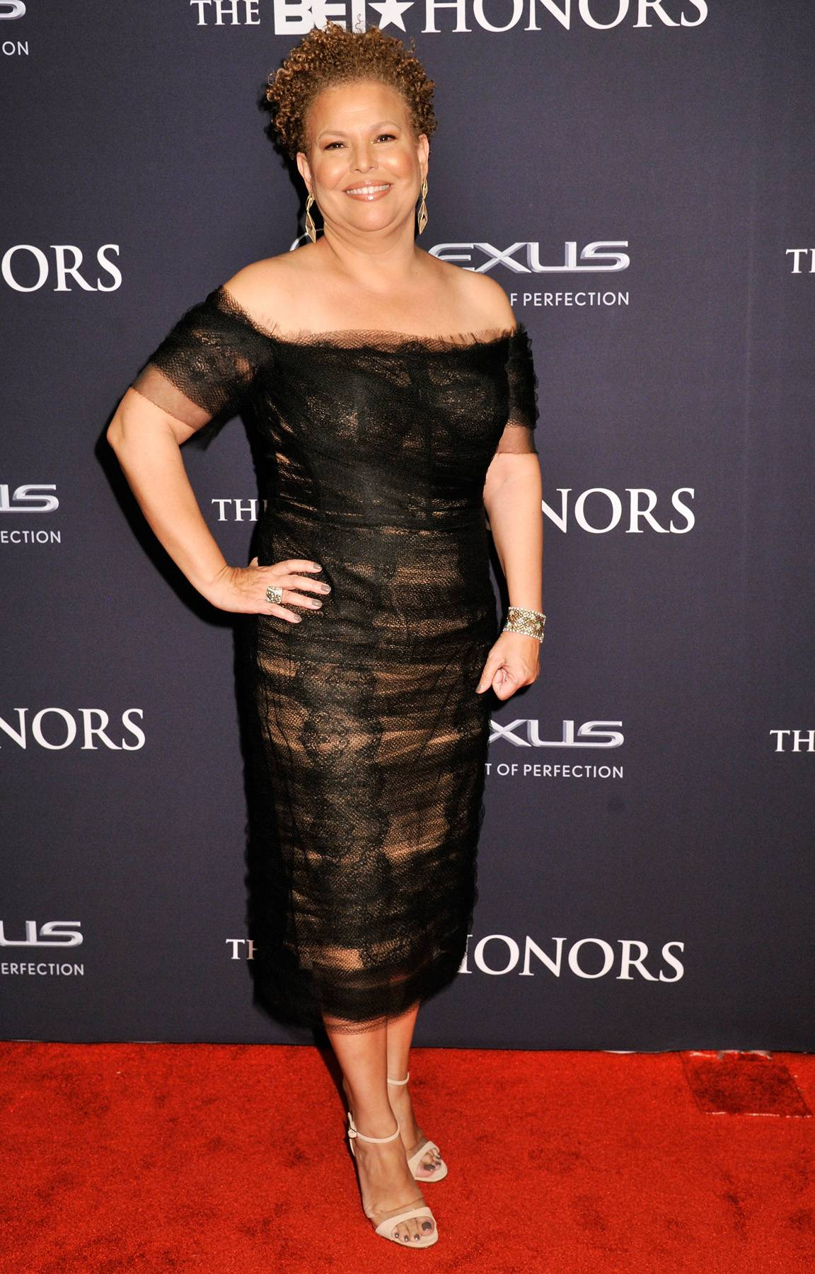 Head of the House  - CEO and Chairman of BET Debra L. Lee graces the red carpet wearing her bright and beautiful smile. Her off-the-shoulder look is sleek and sophisticated. (Photo: Kris Connor/BET/Getty Images for BET)
