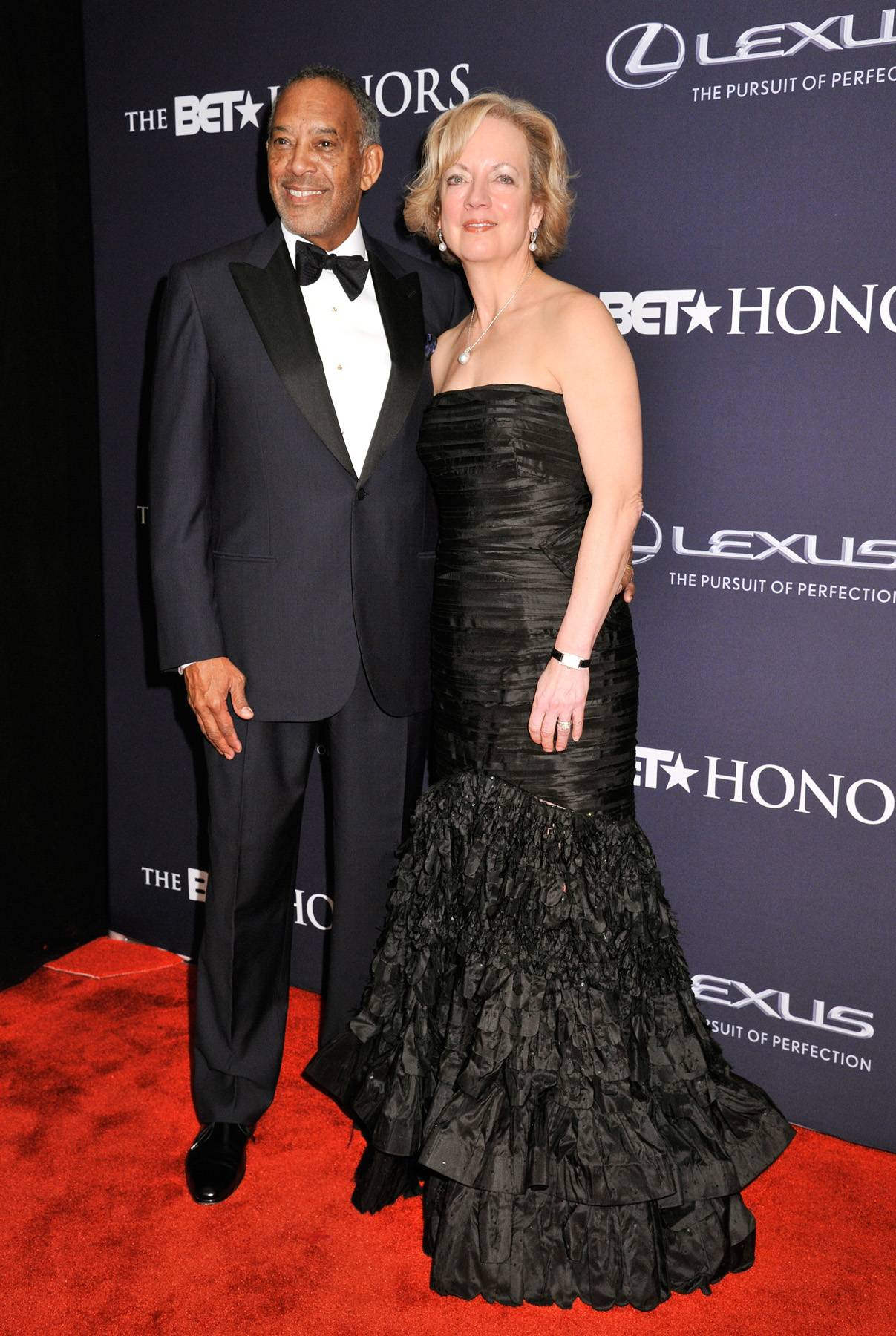 Tech-nically Killin' the Carpet  - The BET Honors Technology and Business HonoreeJohn W. Thompson and gorgeous wife, Sandi Thompson, make a striking appearance on the red carpet. (Photo: Kris Connor/BET/Getty Images for BET)