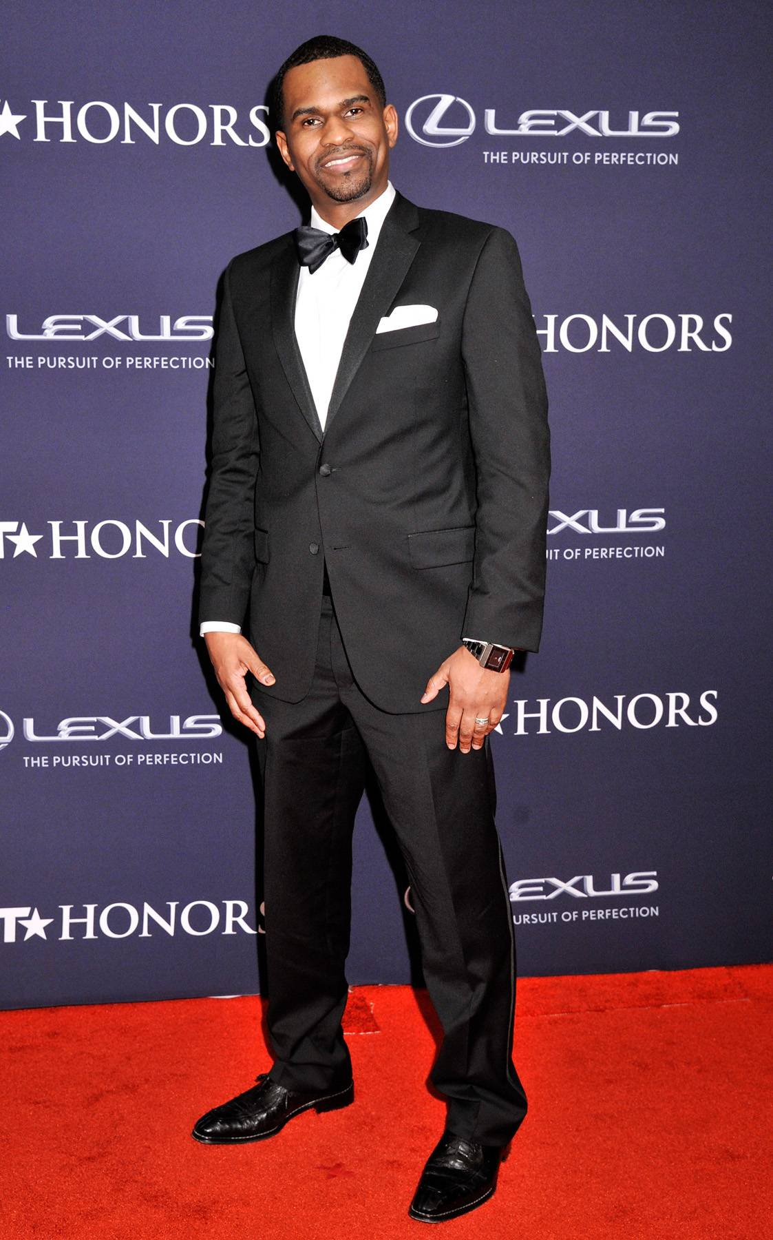 Digital and Daring  - The BET Honors Digital Special Recognition Award goes to Kwame Simmons, who dares to be different with some silly faces on the carpet. (Photo: Kris Connor/BET/Getty Images for BET)