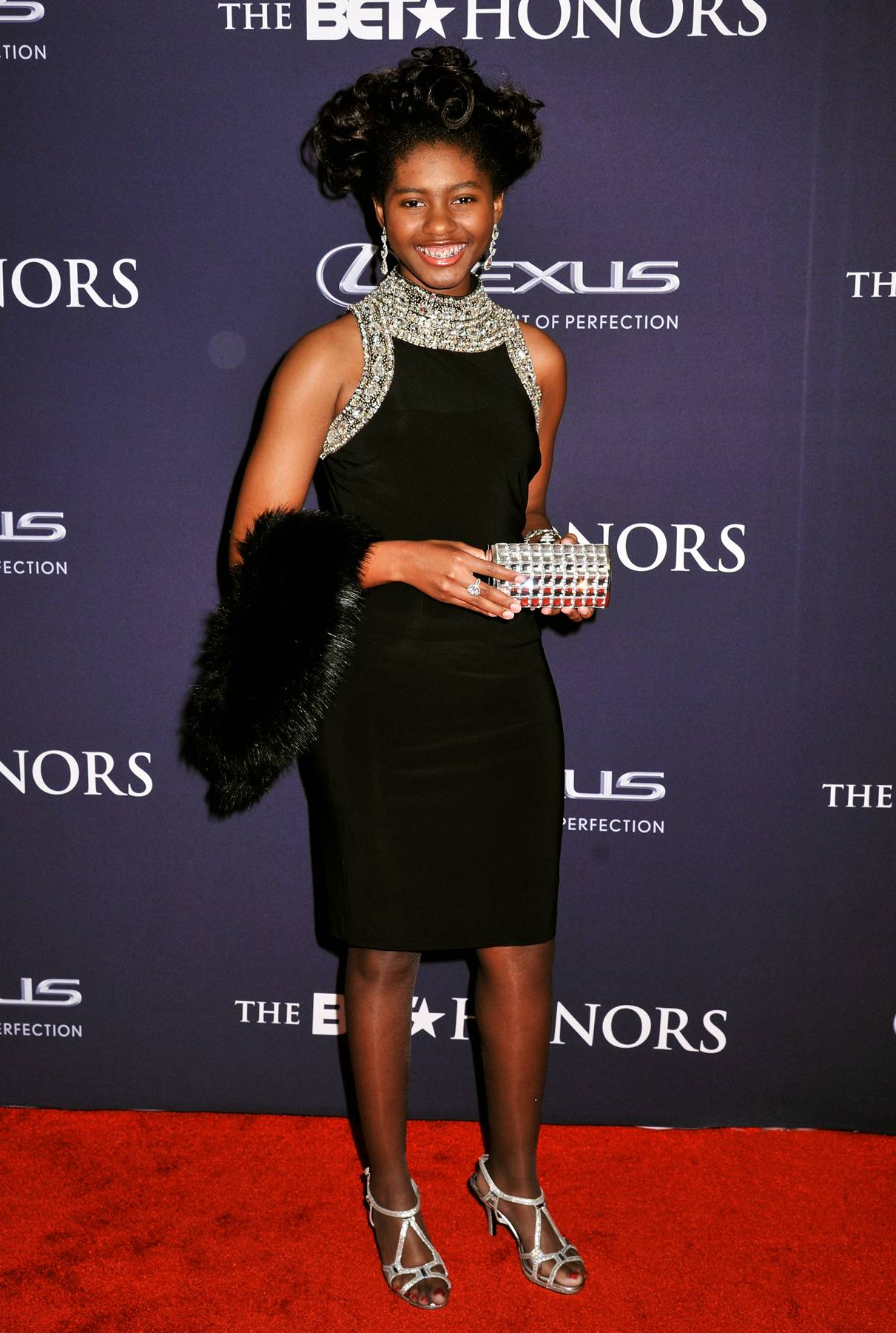 Serving the Silver Lining  - BET Honors Early RiserChental-Song Bembry looks absolutely regal in her midi black dress with a spectacular silver lining. (Photo: Kris Connor/BET/Getty Images for BET)