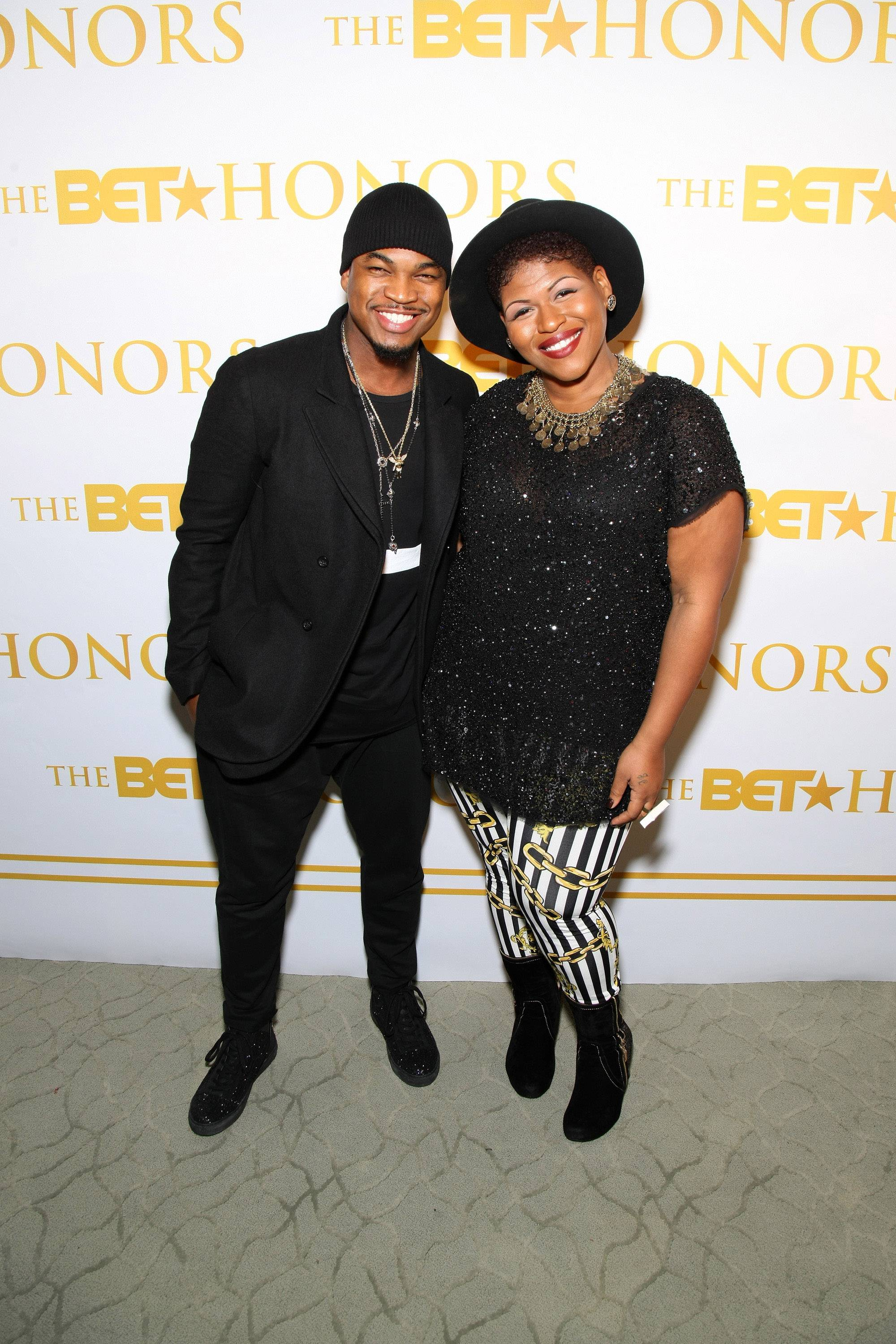 Golden Pens - Ne-Yo and Stacey Barthe are revered for their songwriting and last night they took a break from stroking their musical pens to strike a pose on the red carpet.(Photo: Bennett Raglin/BET/Getty Images for BET)