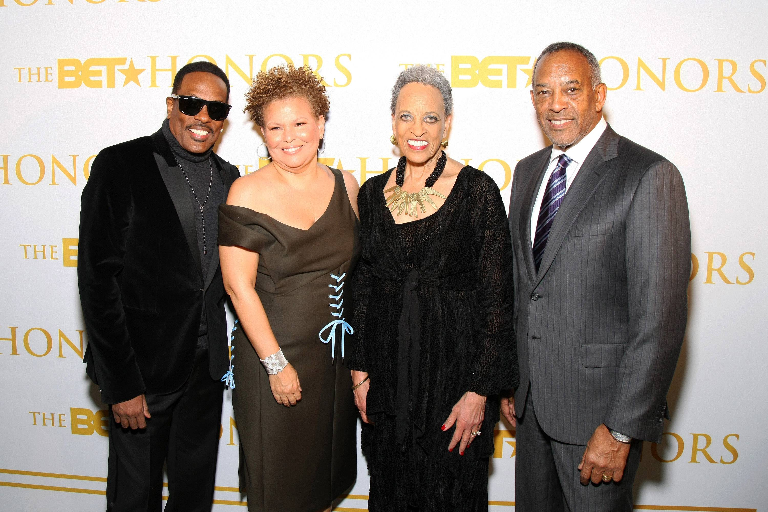 Conviviality at The BET Honors Weekend - Performer Charlie Wilson, Debra Lee and honorees Dr. Johnnetta Betsch Cole and John W. Thompson are snapped dressed to impressed ahead of the taping of The BET Honors.(Photo: Bennett Raglin/BET/Getty Images for BET)